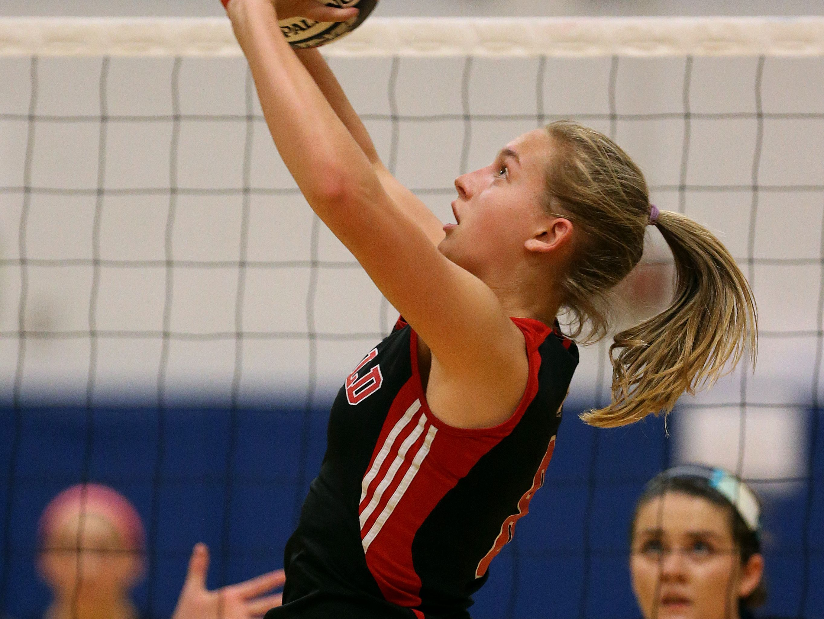 Penfield's Alea Steigerwald sets the ball near the net.