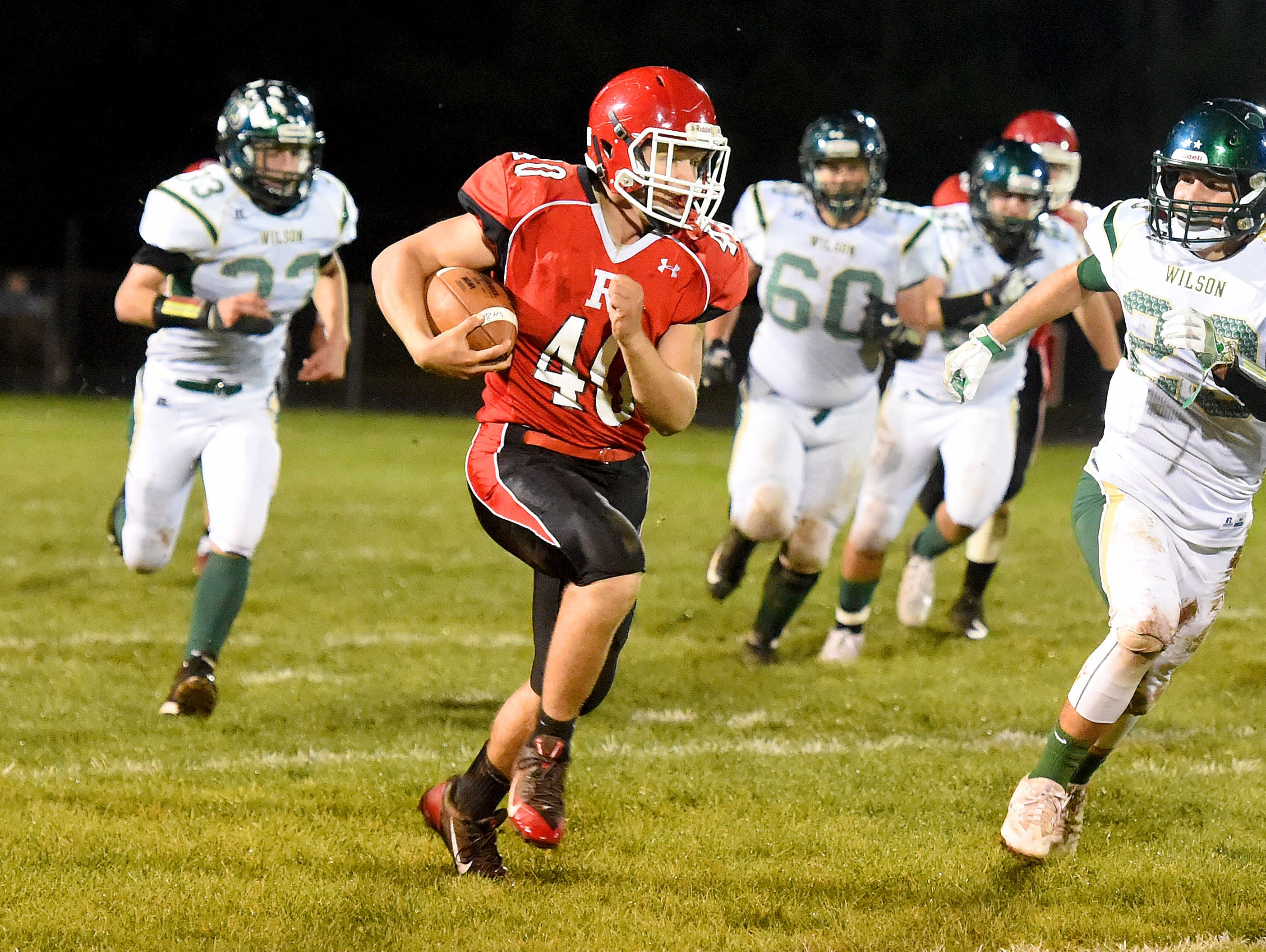 Riverheads' Harrison Schaefer breaks away with the football as Wilson Memorial defenders close in and pursue during a football game played in Greenville on Friday, Oct. 21, 2016. Schaefer makes it into the end zone for a touchdown on the play.