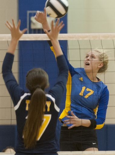 Alli Stumler, a junior All-American for Christian Academy of Indiana, reaches for the ball against Trinity Lutheran on Oct. 25, 2016.