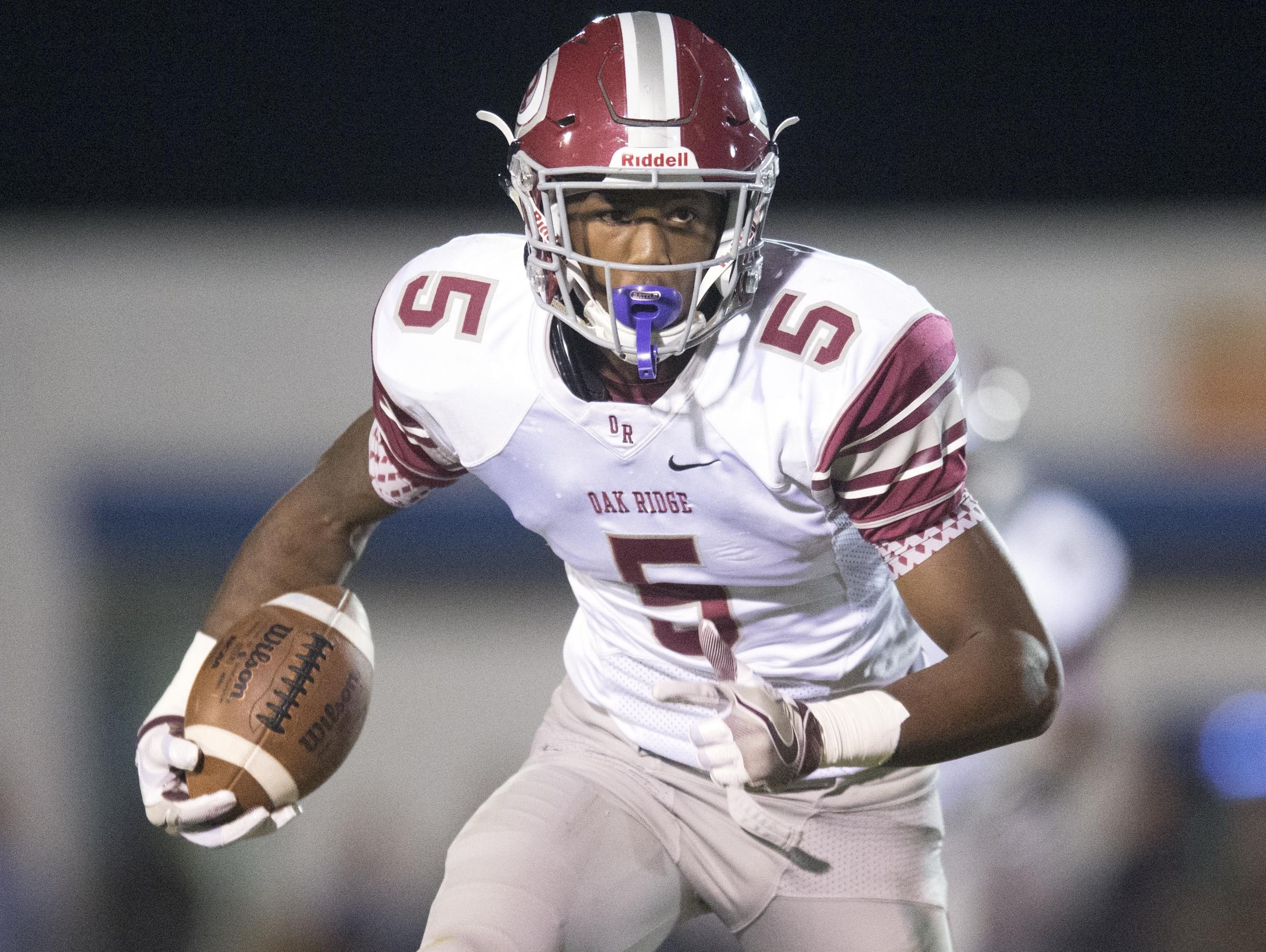 Oak Ridge's Tee Higgins with room to run against Campbell County at Campbell County High School on Thursday, October 27, 2016.