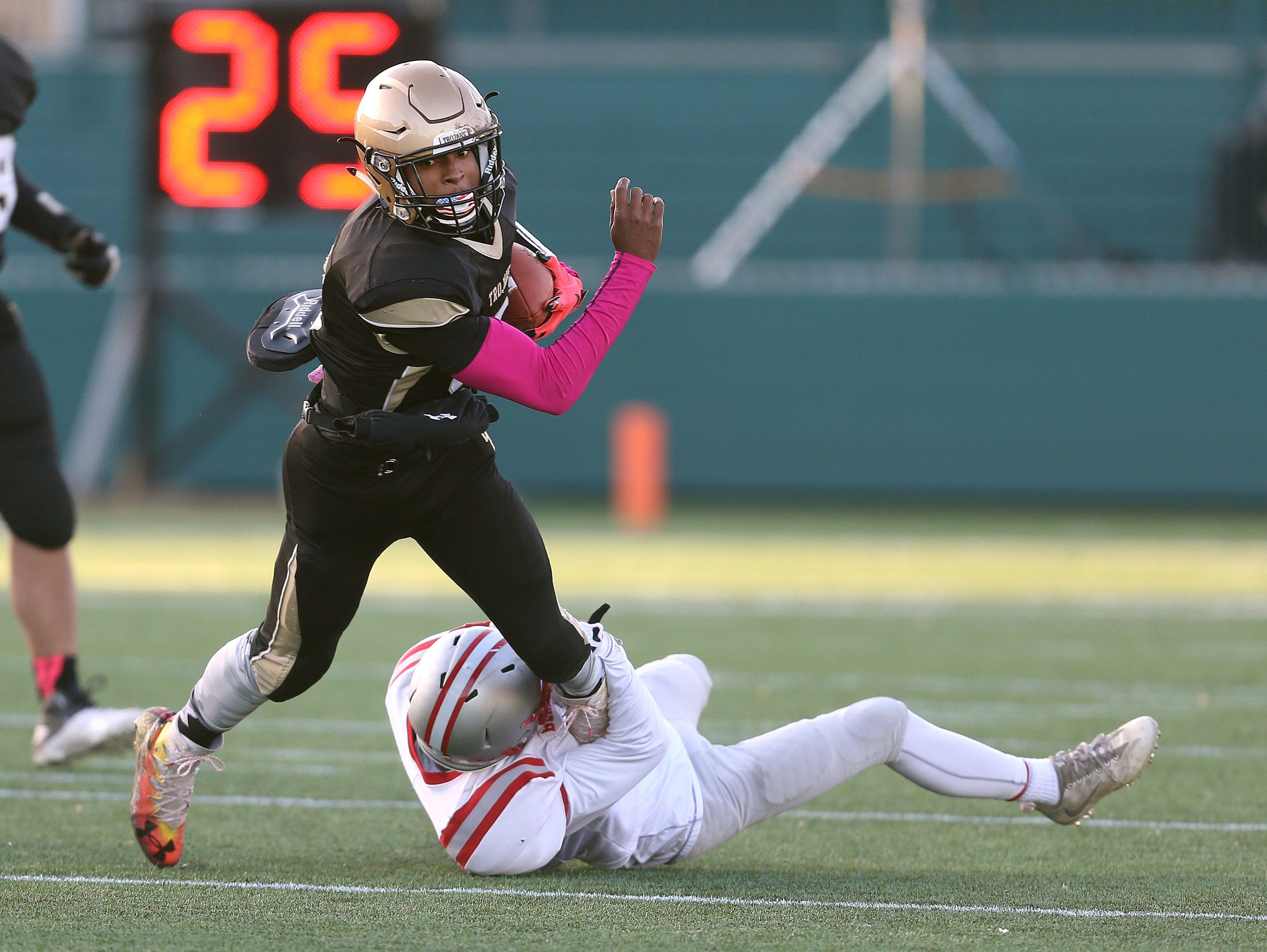 Athena quarterback Ta'von Granison tries to slip through the grasp of Canandaigua's Mitchell Pfeiffer (7).
