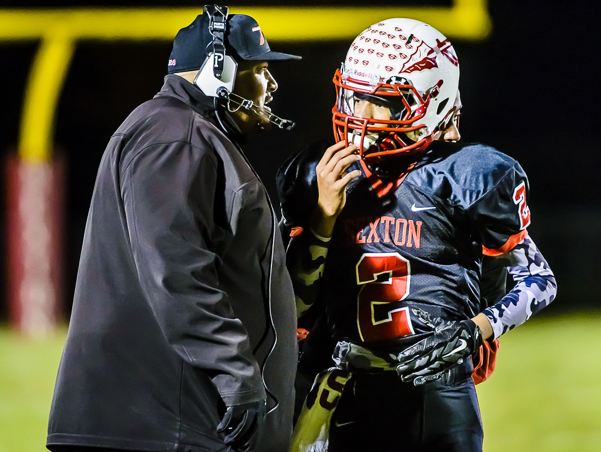 Sexton coach Dan Boggan, shown talking with quarterback Jackson Barnes during a recent game, became the school's career wins leader last week.