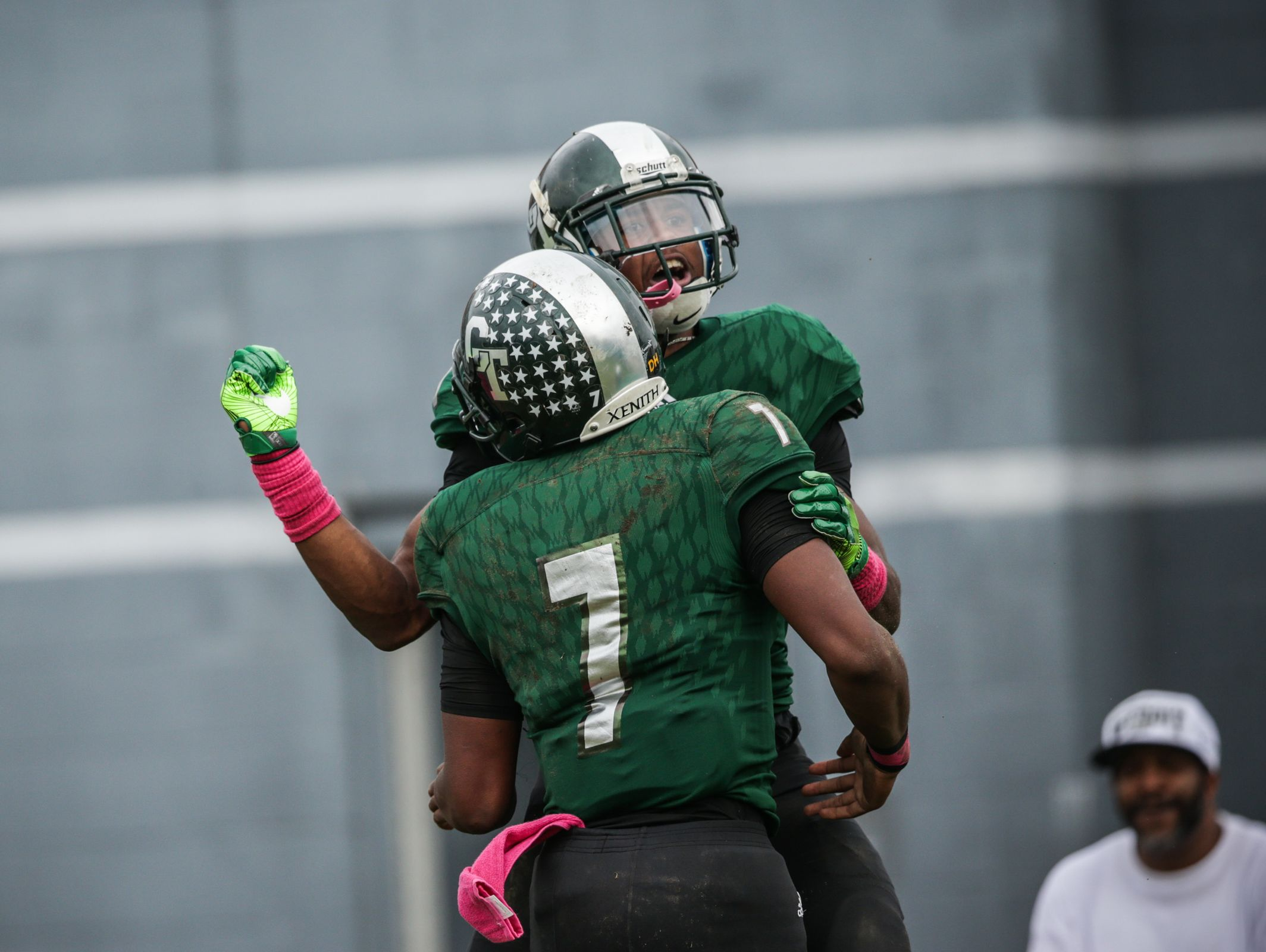 Cass Tech's (9) Donovan Peoples-Jones and (7) Rodney Hall celebrate a touchdown during Cass Tech's 35-7 win over Dearborn Fordson Saturday in Detroit.