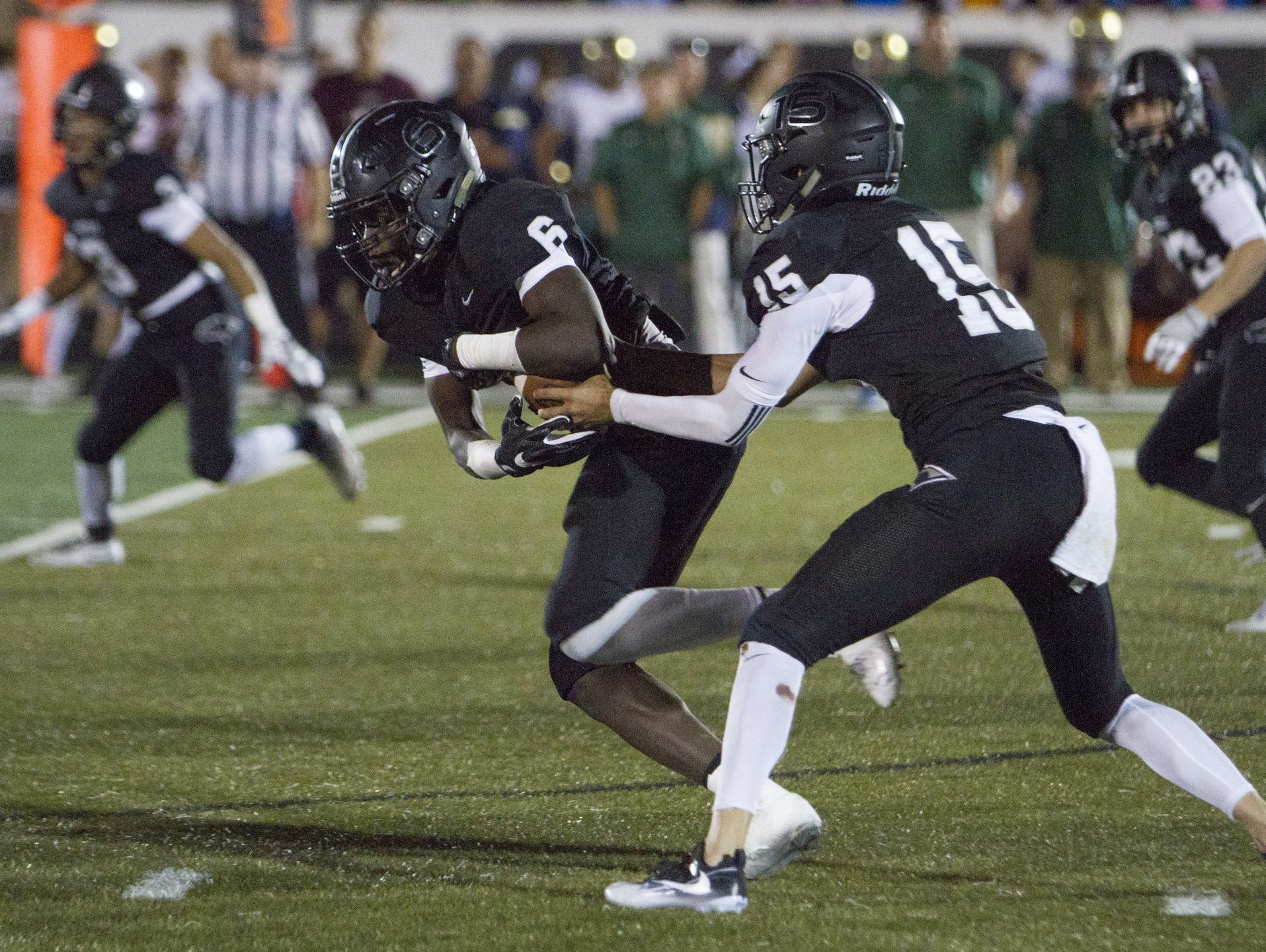 After a long journey, Jacob (No. 6) and D'Angelo Mpungi now call St. George home. Since arriving, the brothers have made a huge impact on the Pine View football team.
