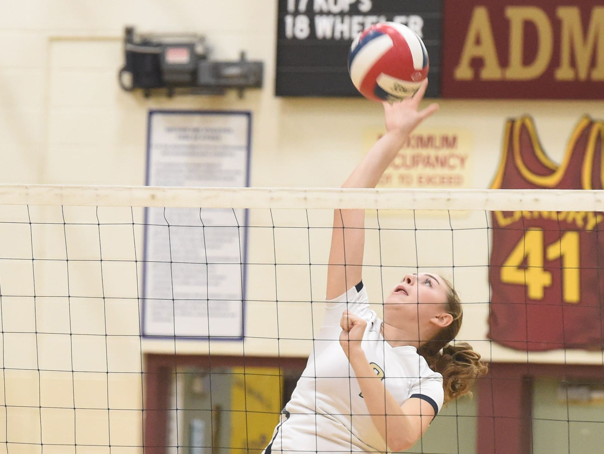 Lourdes' Grace Rappleyea hits the ball over the net during Tuesday's game against Nanuet.