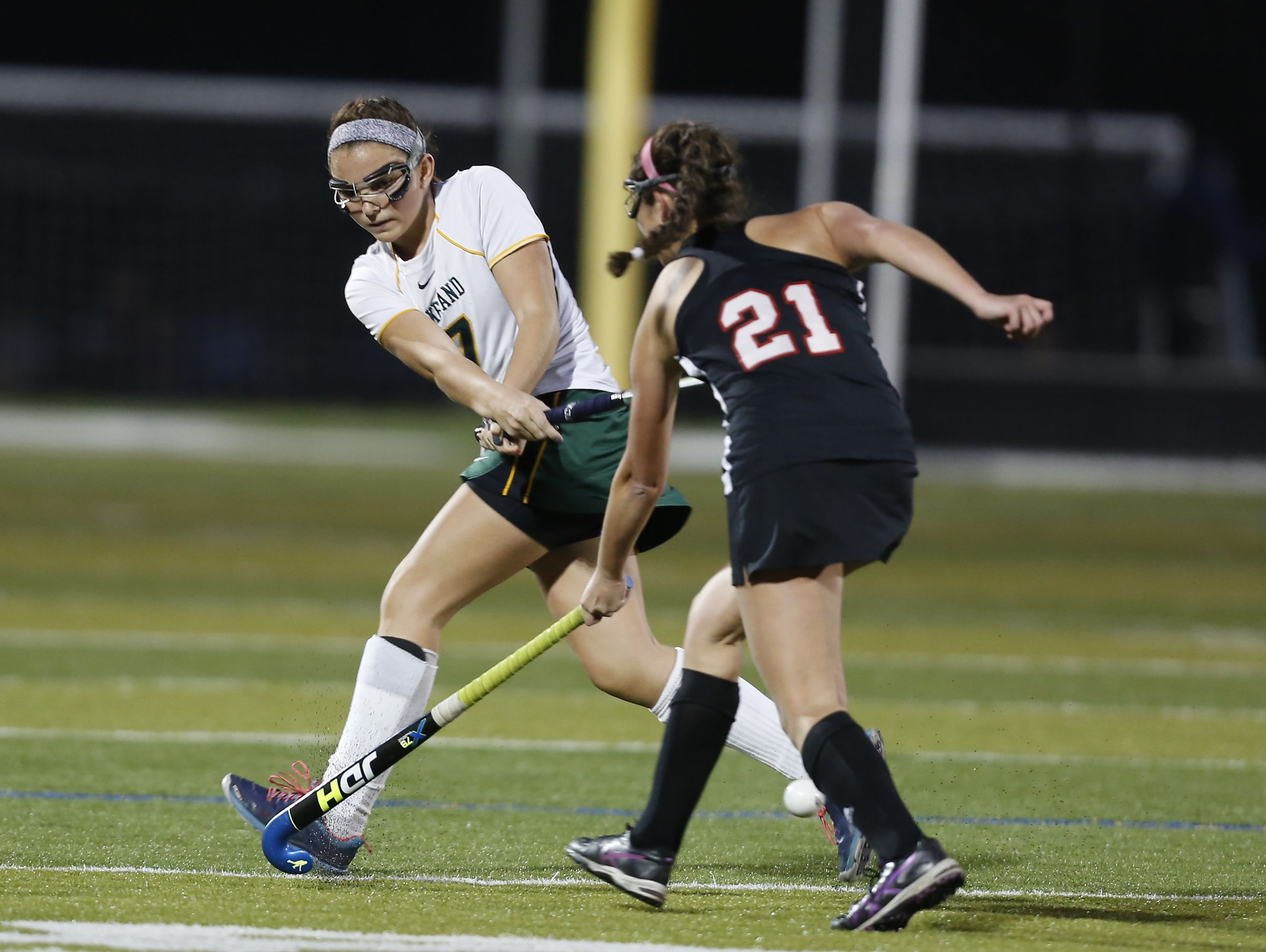 Lakeland's Caroline Cahill pass the ball around Rys's Kally Ott (21) during their 4-1 win in the Class B field hockey section finals at Brewster High School on Tuesday, November 1, 2016.