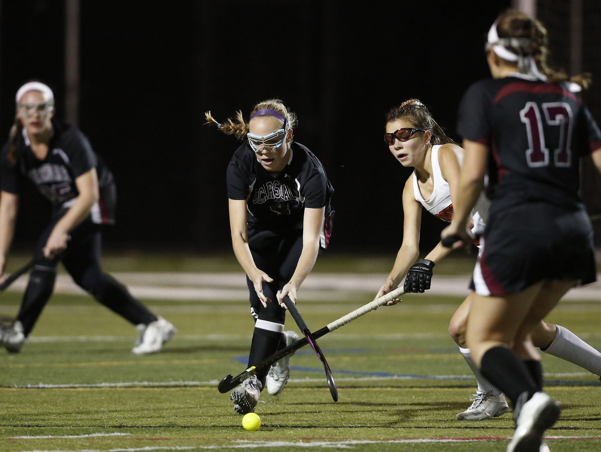 Scarsdale's Emma Coleman (4) reaches for the ball in their 2-0 win over mamaroneck in the Class A field hockey section finals at Brewster High School on Tuesday, November 1, 2016.