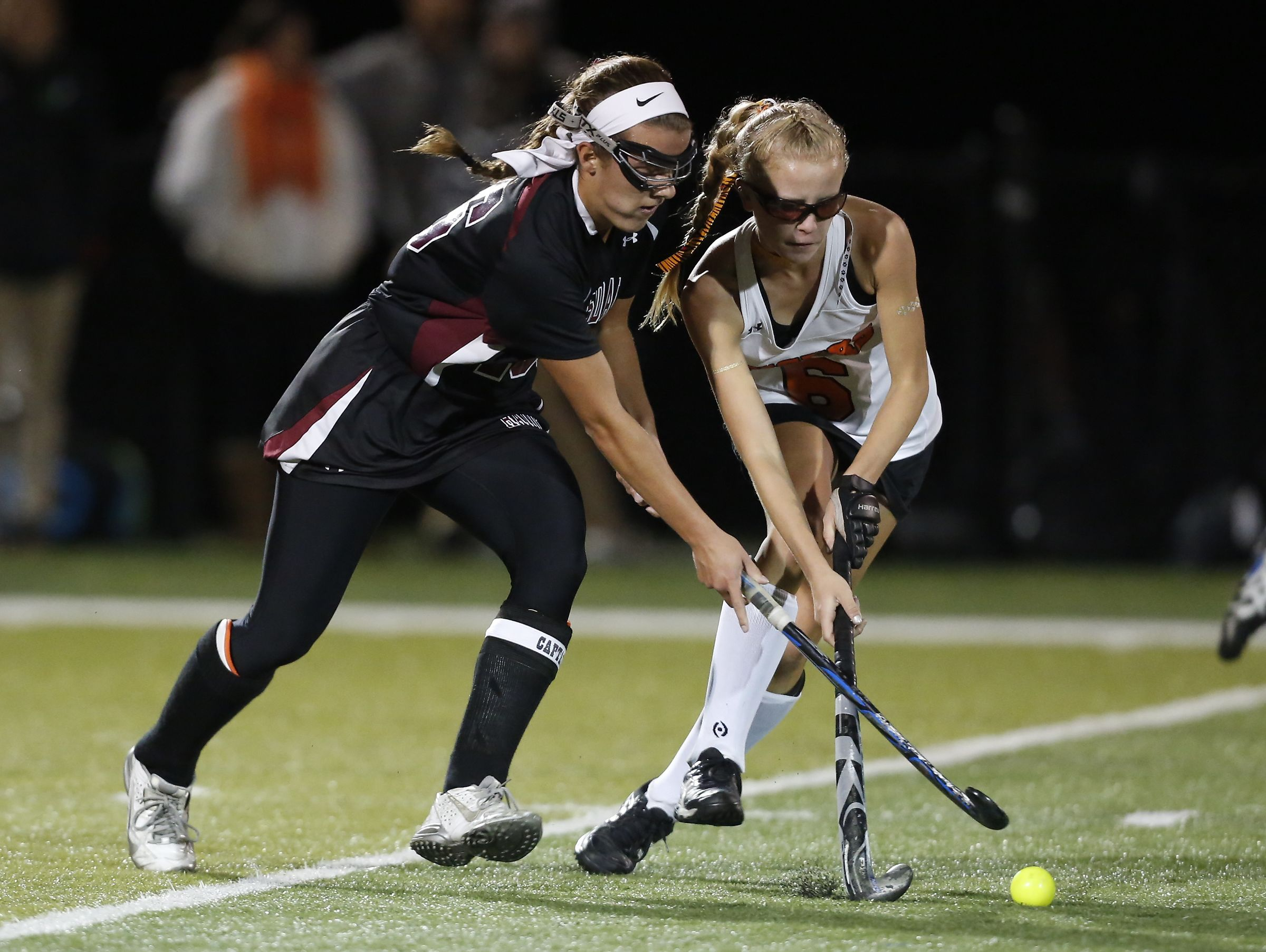 Scarsdale's Erin Nicholas (16) and Mamaroneck's Elizabeth Brissette (6) battle for possession in the Class A field hockey section finals at Brewster High School on Tuesday, November 1, 2016. Scarsdale won 2-0.