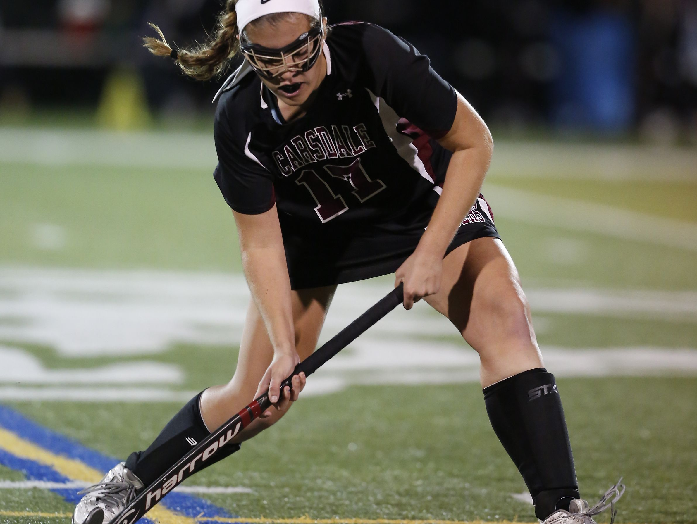 Scarsdale's Paide Danehy (17) feeds a pass in the Class A field hockey section finals against Mamaroneck at Brewster High School on Tuesday, November 1, 2016.
