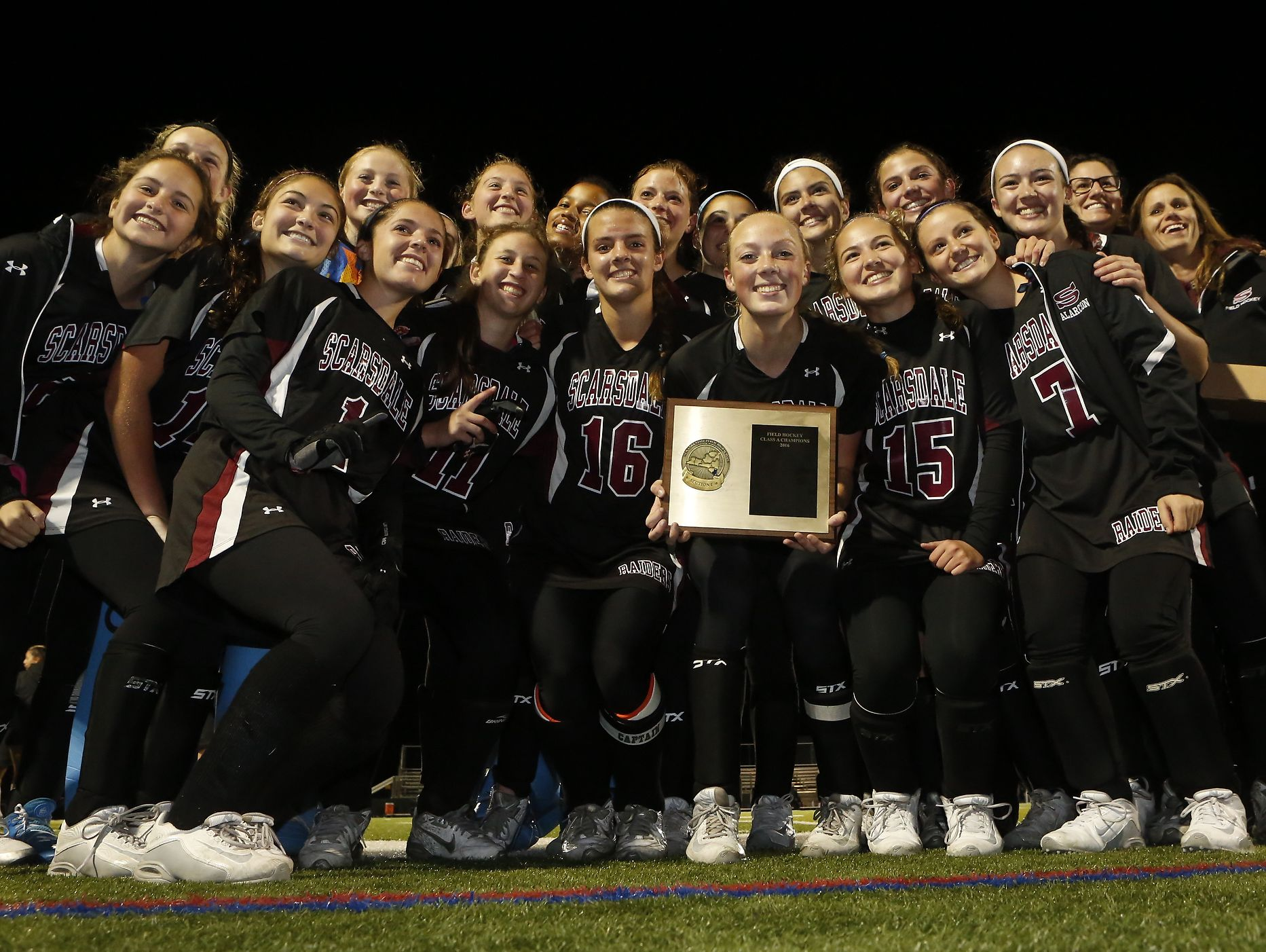 Scarsdale celebrates their 2-0 win over Mamaroneck in the Class A field hockey section finals at Brewster High School on Tuesday, November 1, 2016.