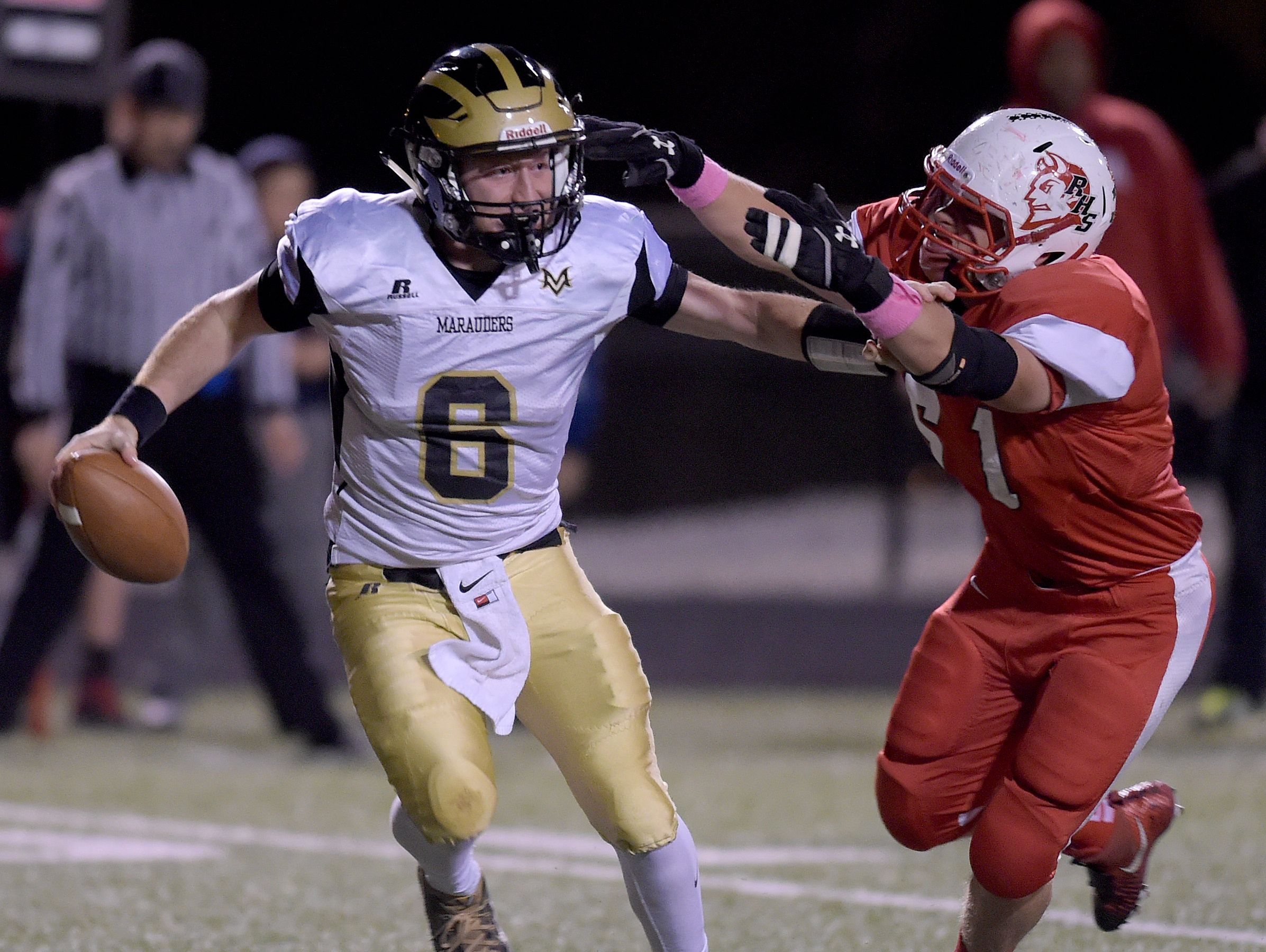 Quarterback Zac Montgomery (left) will try to guide Mt. Vernon to another sectional title.