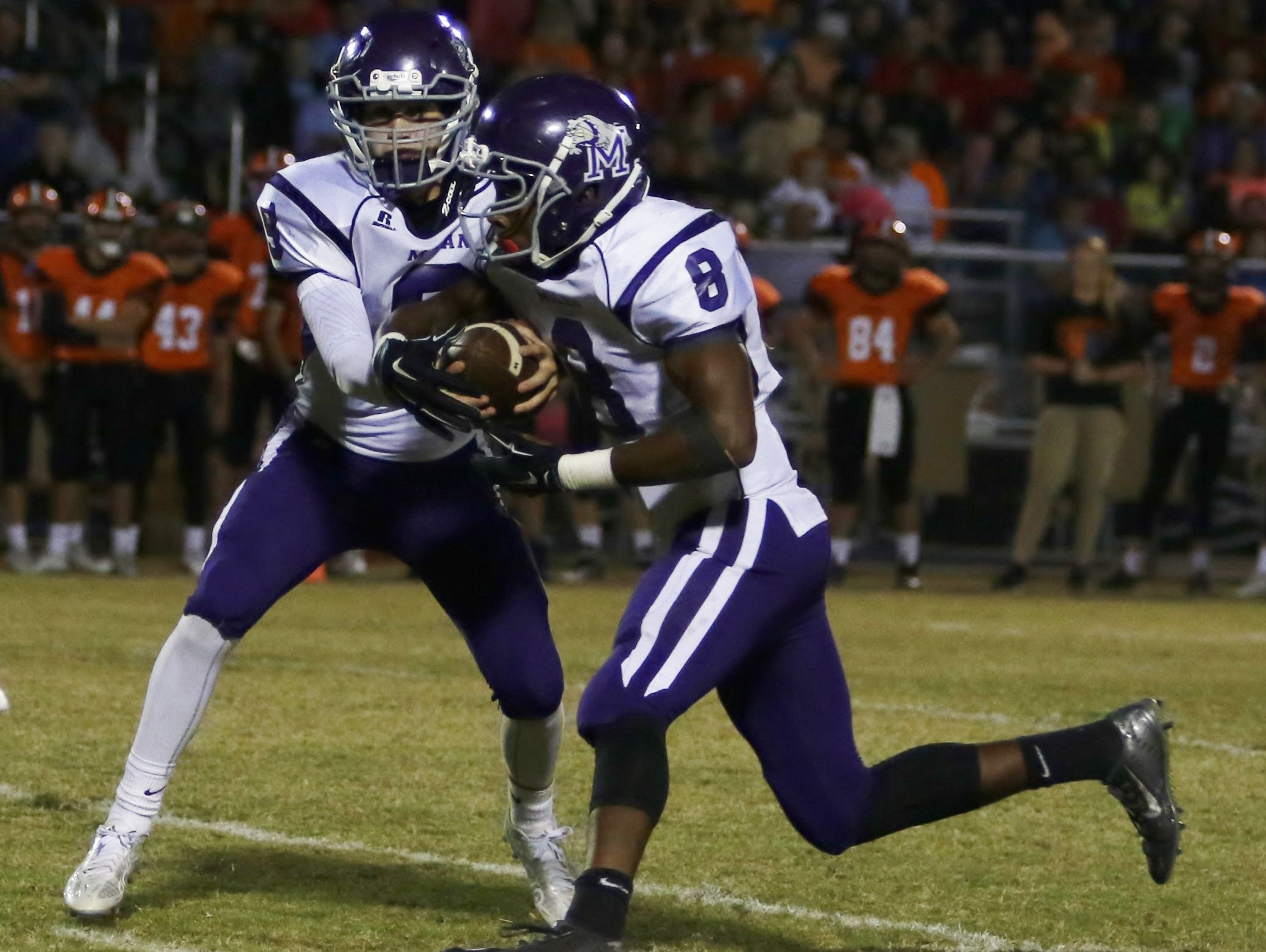 Milan's Anthony Ballard takes a handoff from Taylor Lockhart during Friday?s game last week at South Gibson.