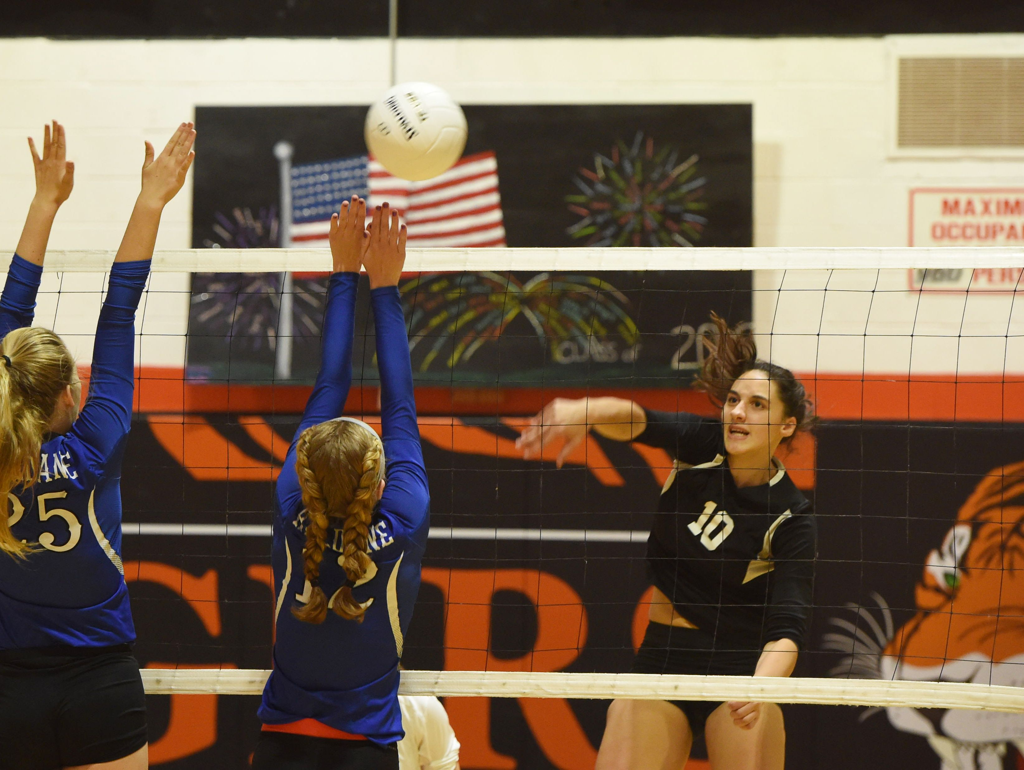 Pawling's Jaclyn Smith, right, hits the ball over the net during Wednesday's game against Haldane.