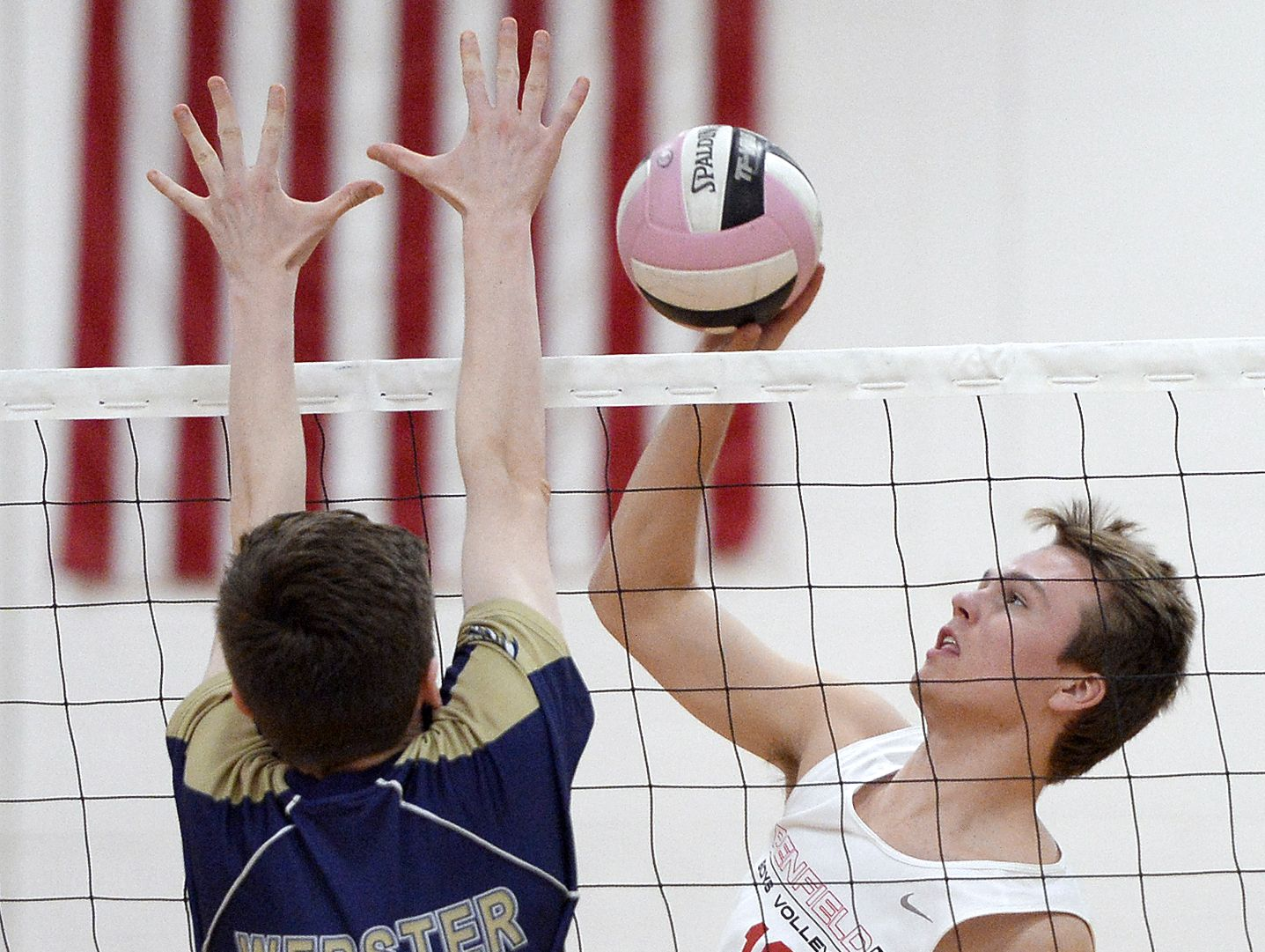 Penfield's Shawn O'Malley, right, hits against the block of Webster's Eli Holley during a Section V Class A quarterfinal.