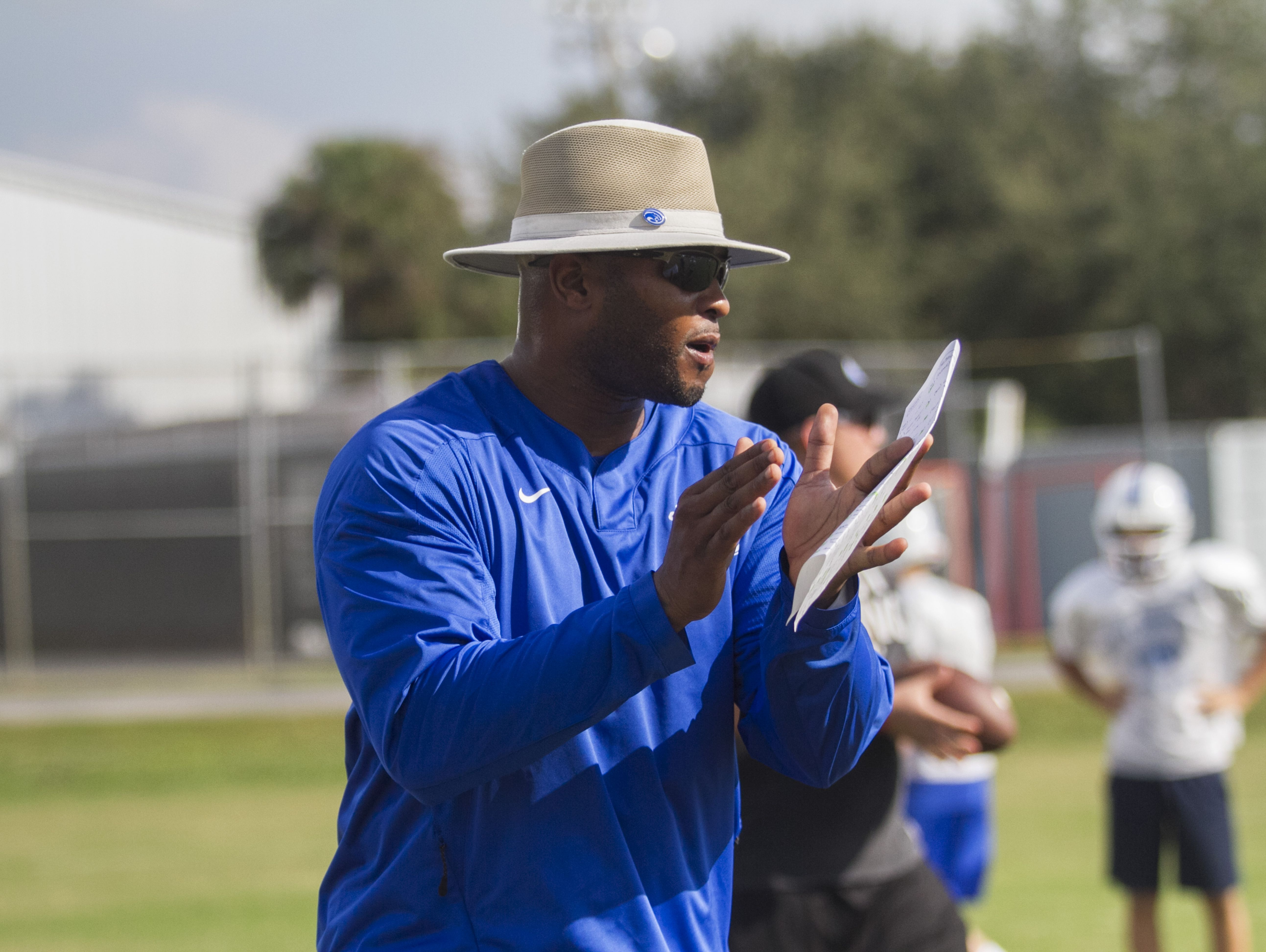 Derrick Crudup Jr. works with his team during football practice on Wednesday at The Canterbury School.