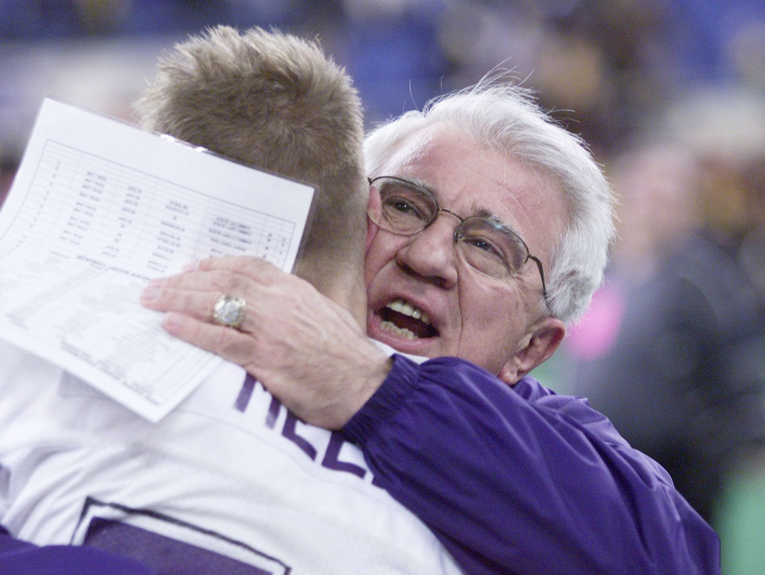 5_class5af.#78112-Ben Davis head coach Dick Dullaghan celebrates his seventh state championship with player Brian Meeks Saturday at the RCA Dome. The Giants defeated Ft. Wayne Snyder 31-7.WITH STORY(STEVE HEALEY/STAFF PHOTO)
