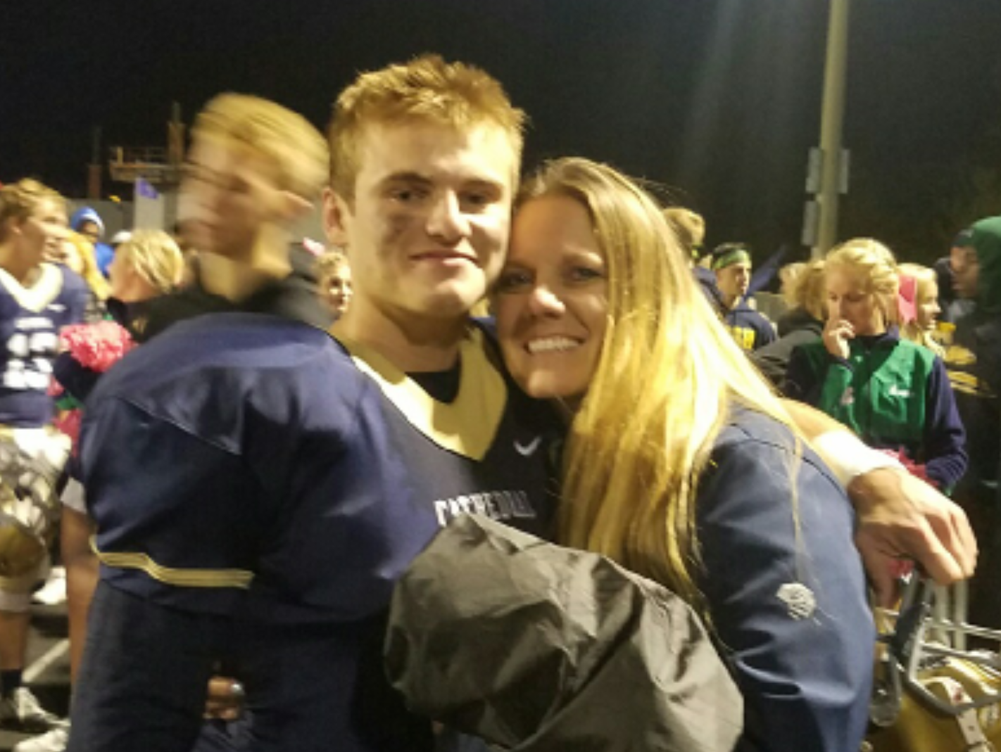 Quincy Keller plays QB for Cathedral. His mom, Stephanie, coaches basketball for Lawrence Central. The Irish face the Bears on Friday.