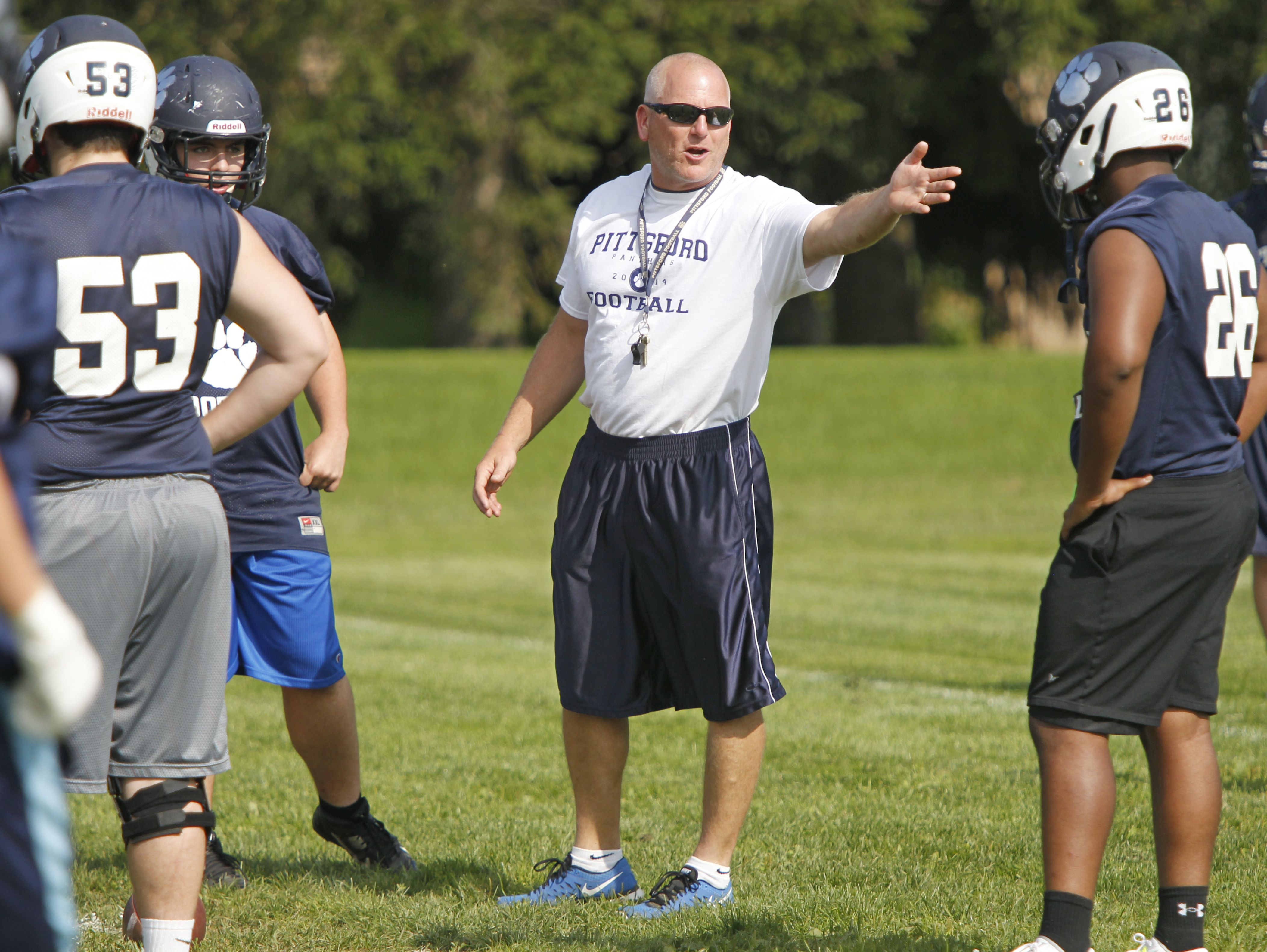 Pittsford head coach Keith Molinich directs his lineman through drills during their practice in this 2014 file photo.