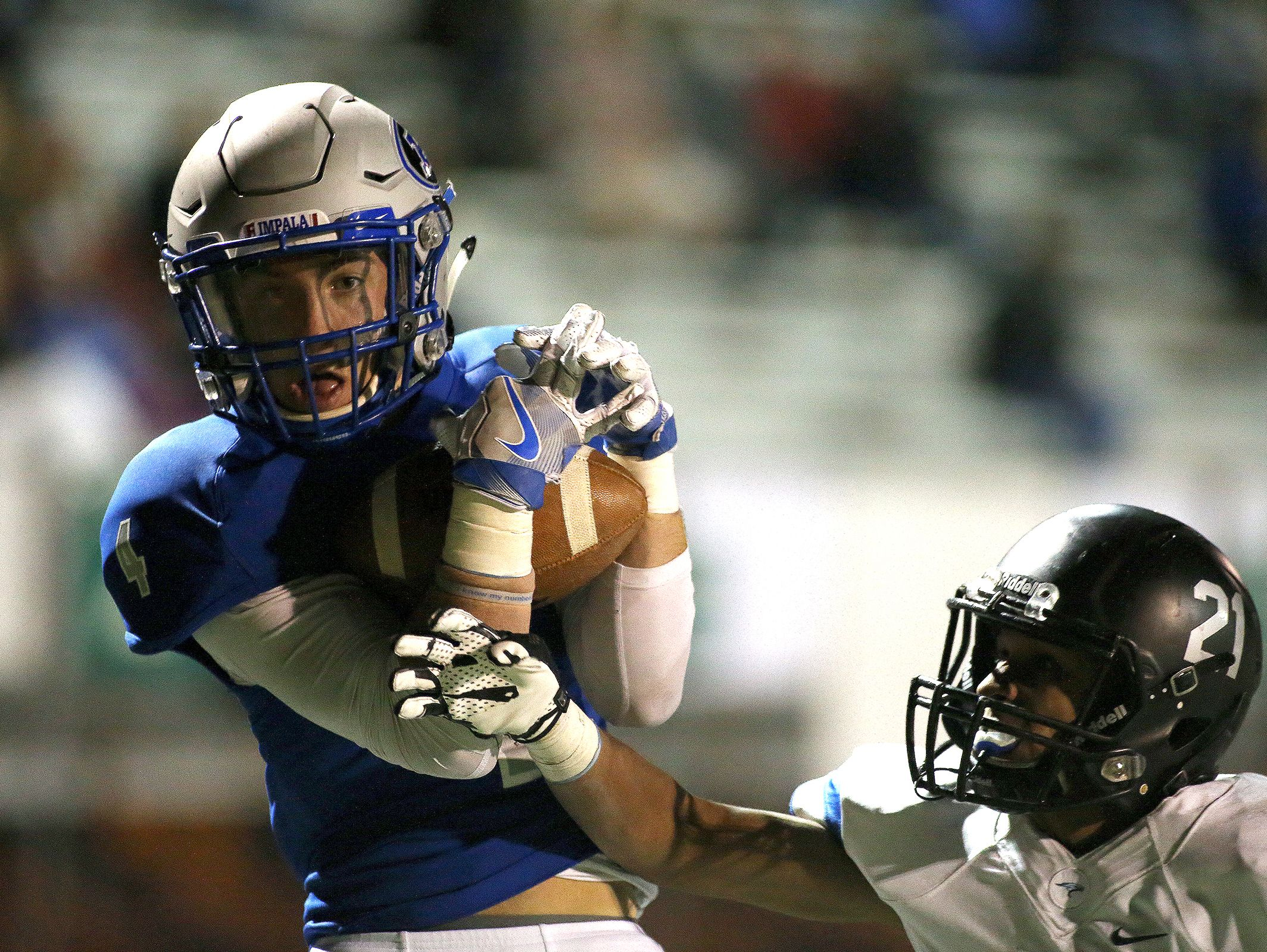 Poudre wide receiver Ryan Selby catches a touchdown pass during the Poudre High Impalas' 35-24 loss to the Highlands Ranch Falcons on Thursday.