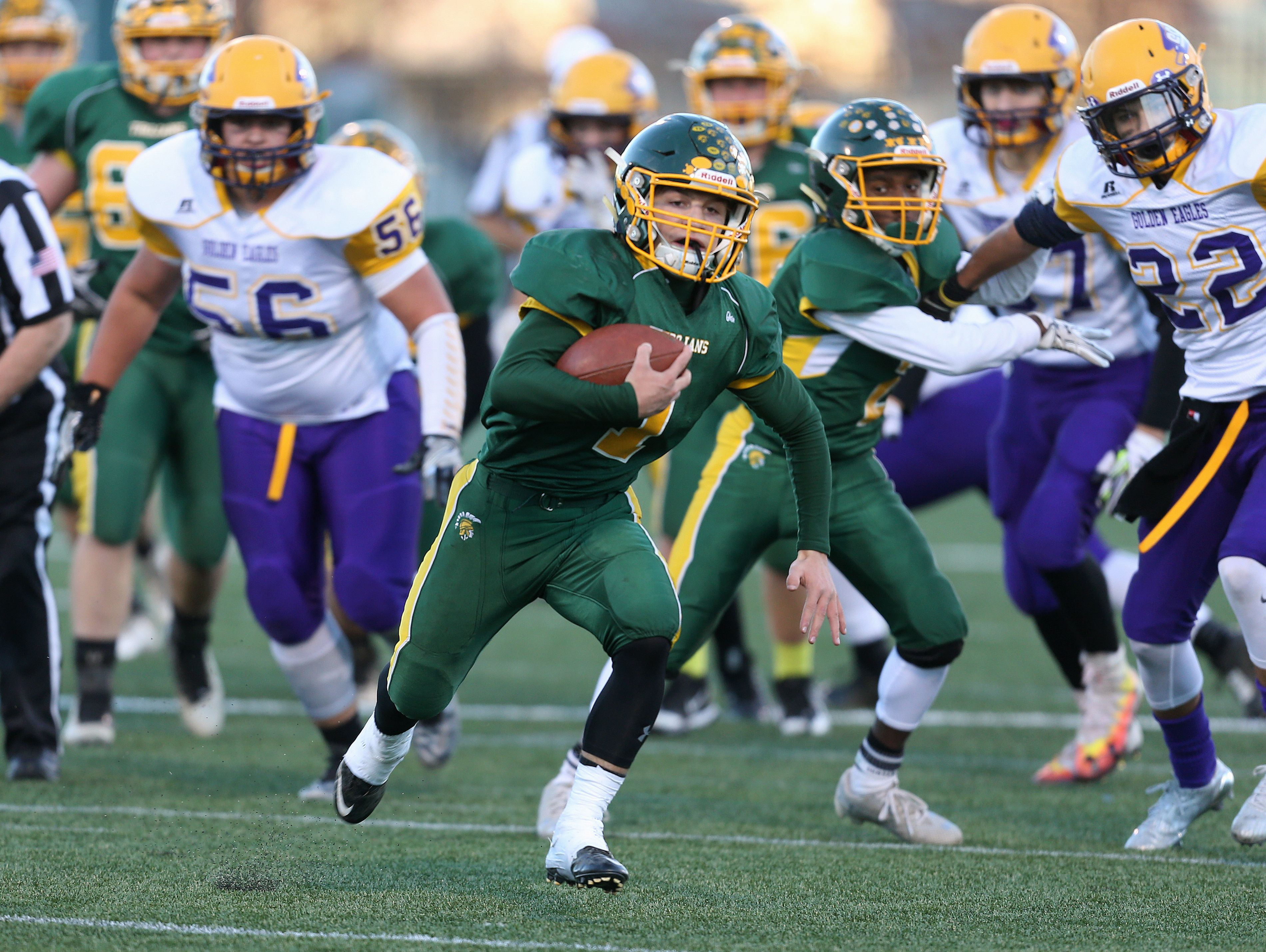Alexander running back Dane Heberlein breaks through the Clyde-Savannah defensive line.