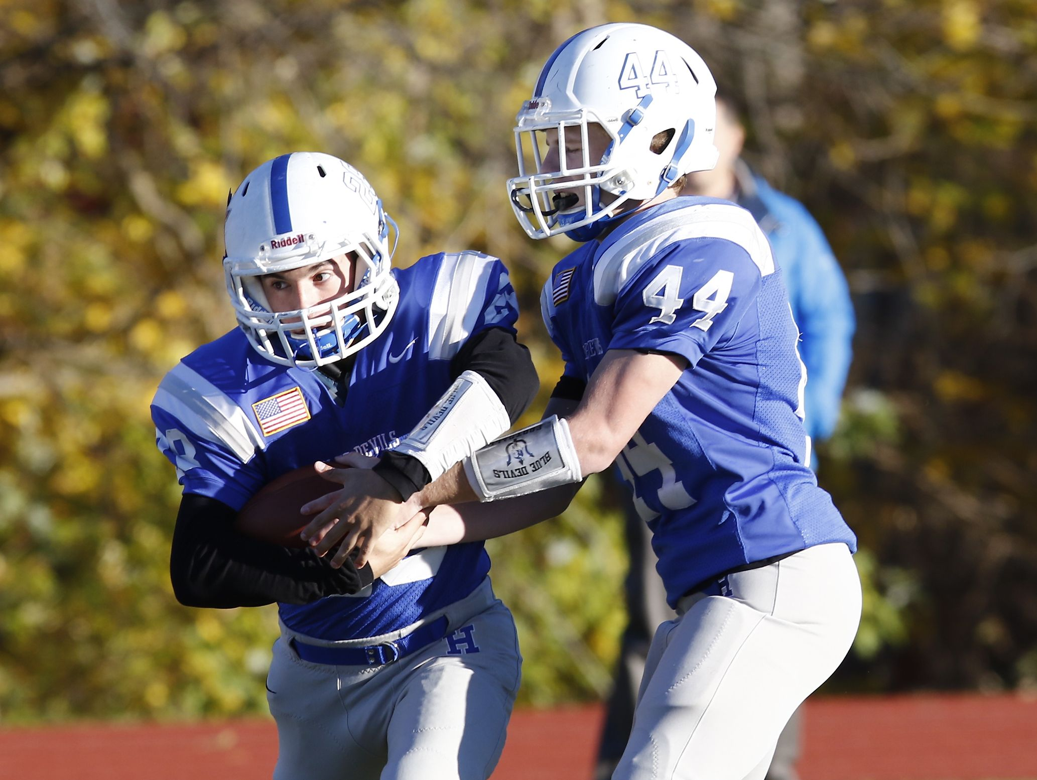 Haldane's Sam Giachinta (44) hands off to Joe Digregorio (28) during their 26-6 win over Tuckahoe in the Section 1 Class D championship football game at Mahopac High School on Friday, November 4, 2016.