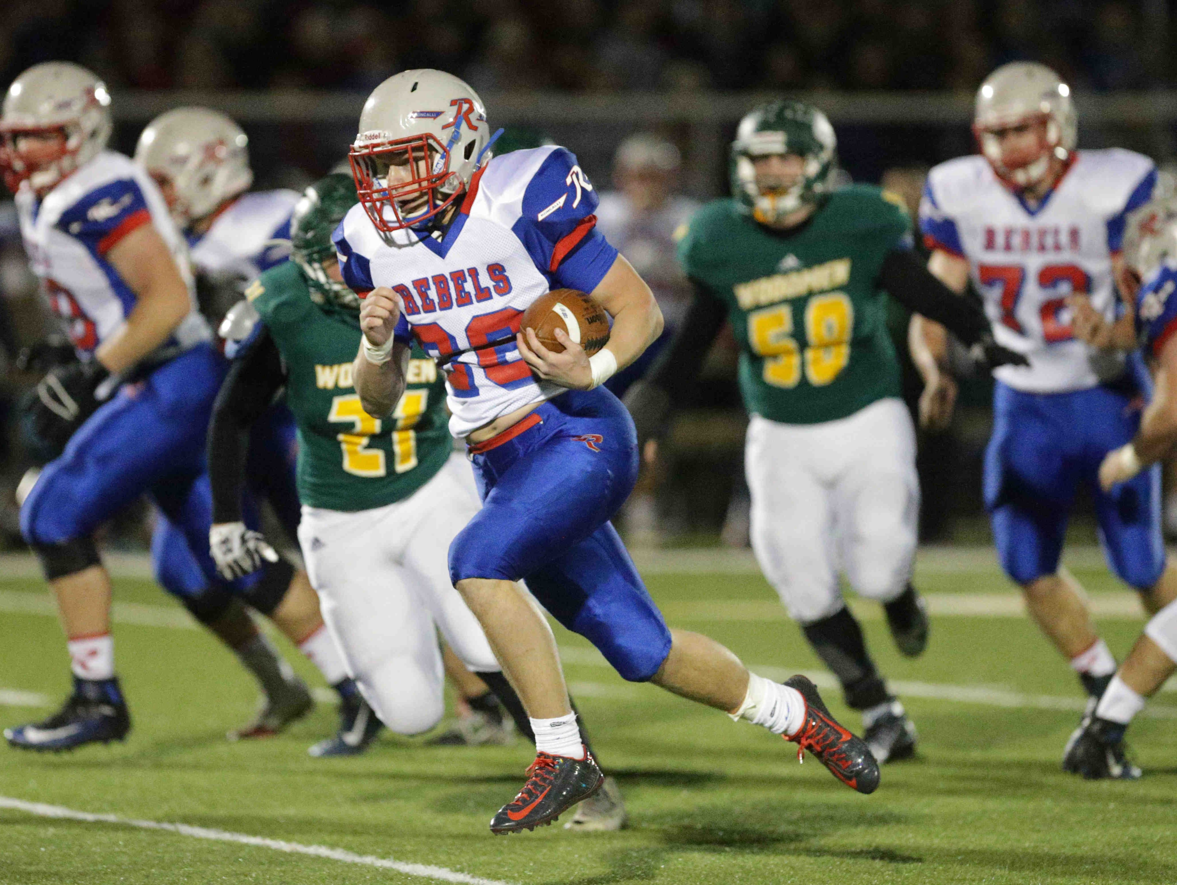 Roncalli's No. 26, Patrick McManama carries the ball, as Greenwood Community High School takes on Roncalli High School at Greenwood, Friday November 4th, 2016.