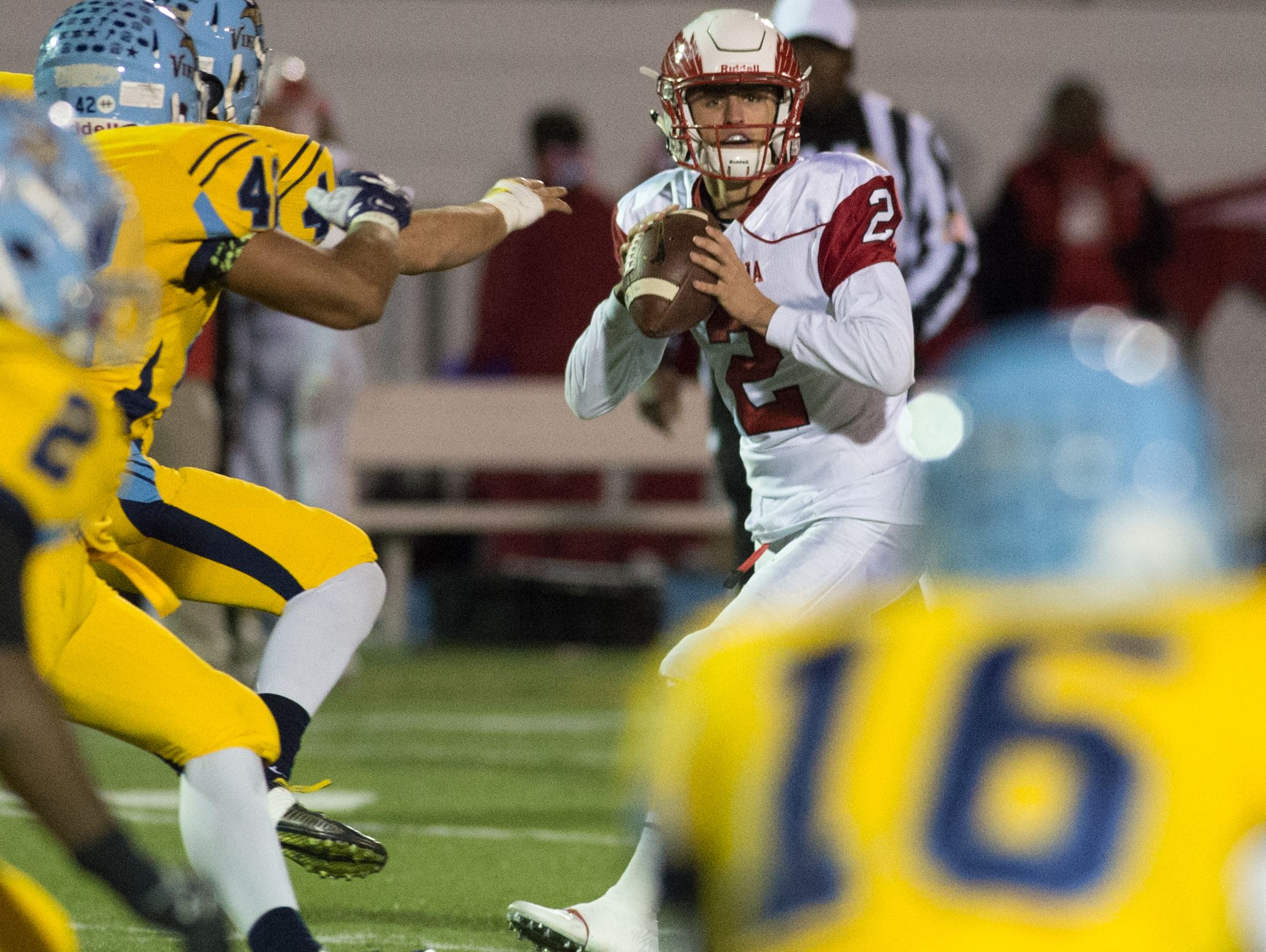 Smyrna's Nolan Henderson (2) looks down field for a receiver in their game against Cape Henlopen.