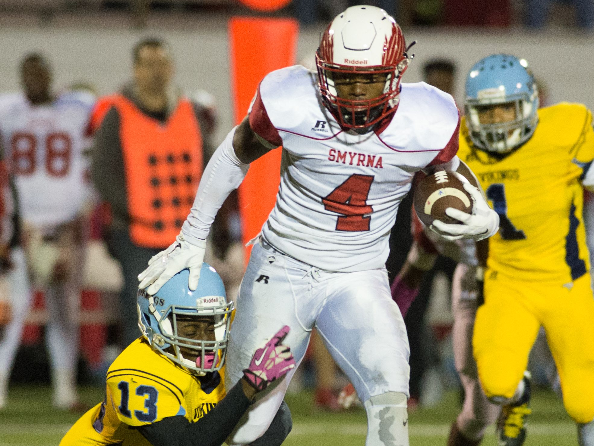 Cape Henlopen's Keith Mumford-Reed (13) makes a tackle on Smyrna's Leddie Brown (4).