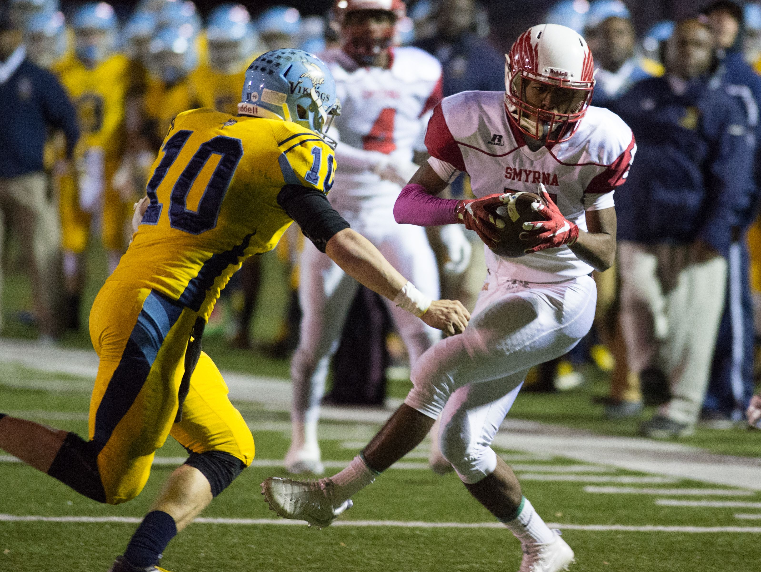 Smyrna's Emon Roberts (5) completes a catch near the sideline in their game against Cape Henlopen.