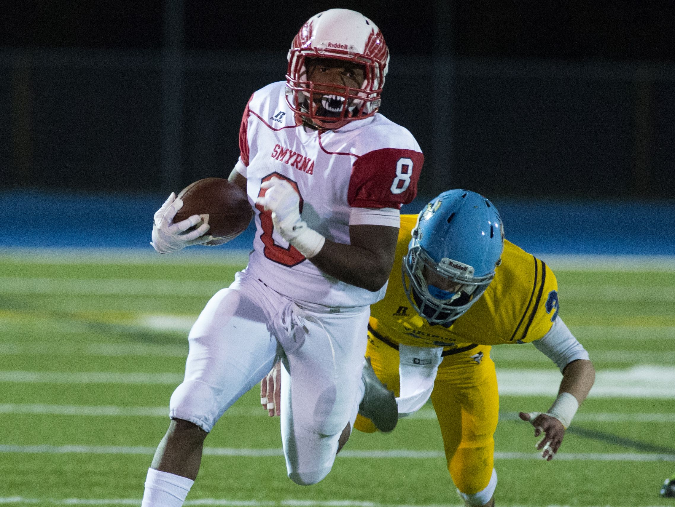 Smyrna's Keshaun Tolbert (8) runs with the ball down the field in their game against Cape Henlopen.