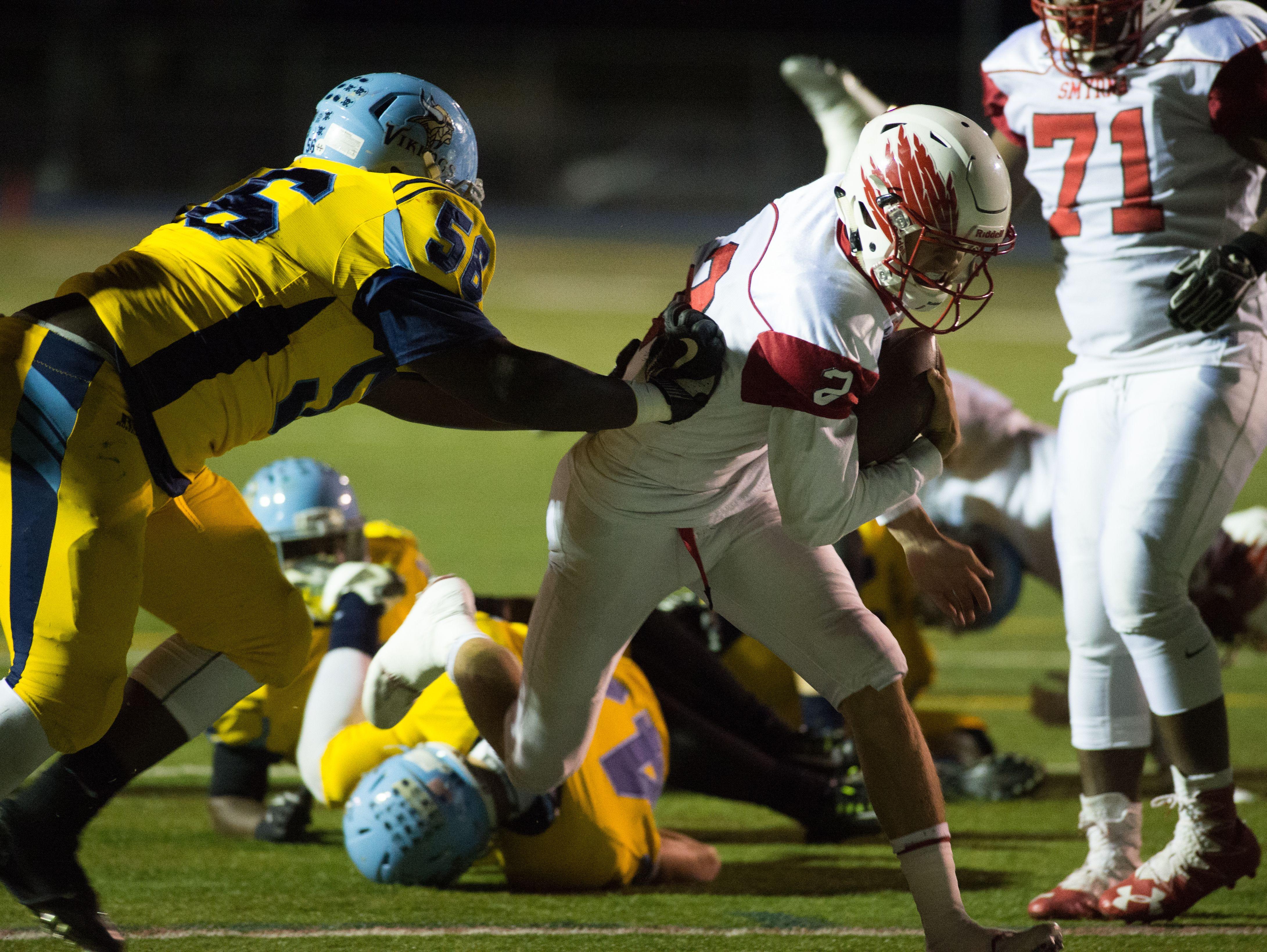 Smyrna's quarterback Nolan Henderson (2) runs in for their first touchdown against Cape Henlopen.