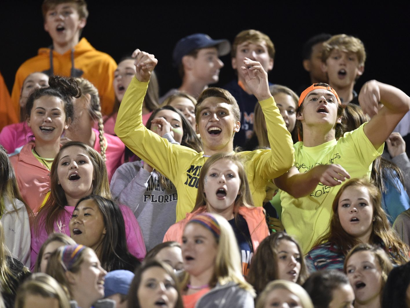 Summit High School fans celebrate a touchdown against Cane Ridge High School.