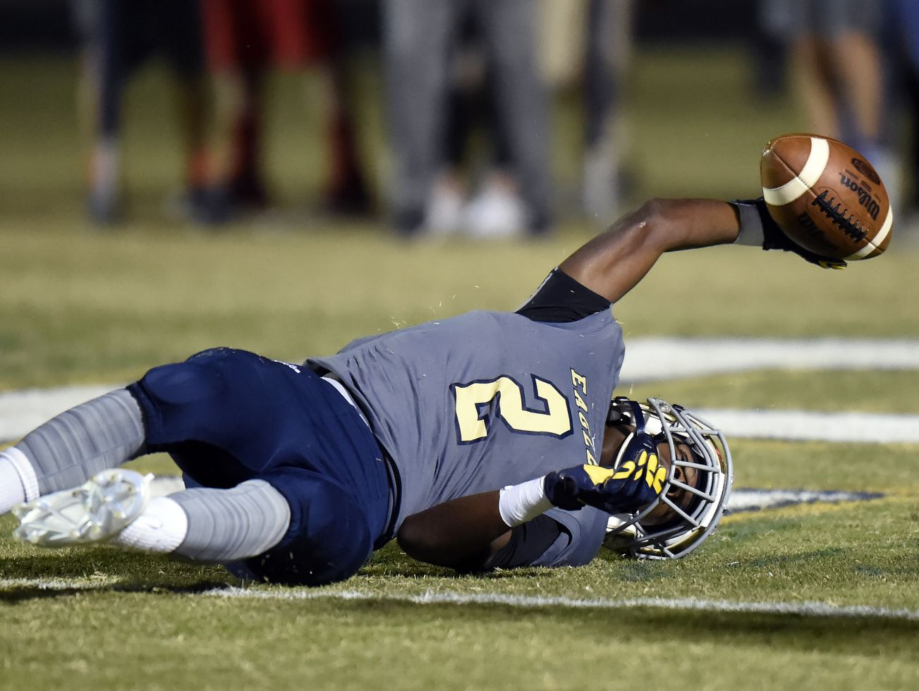 Independence wide receiver T.J. Sheffield (2) lies on the ground after catching a touchdown pass against Gallatin during the first of an high school football playoff game on Friday, Nov. 4, 2016, in Thompson's Station, Tenn.