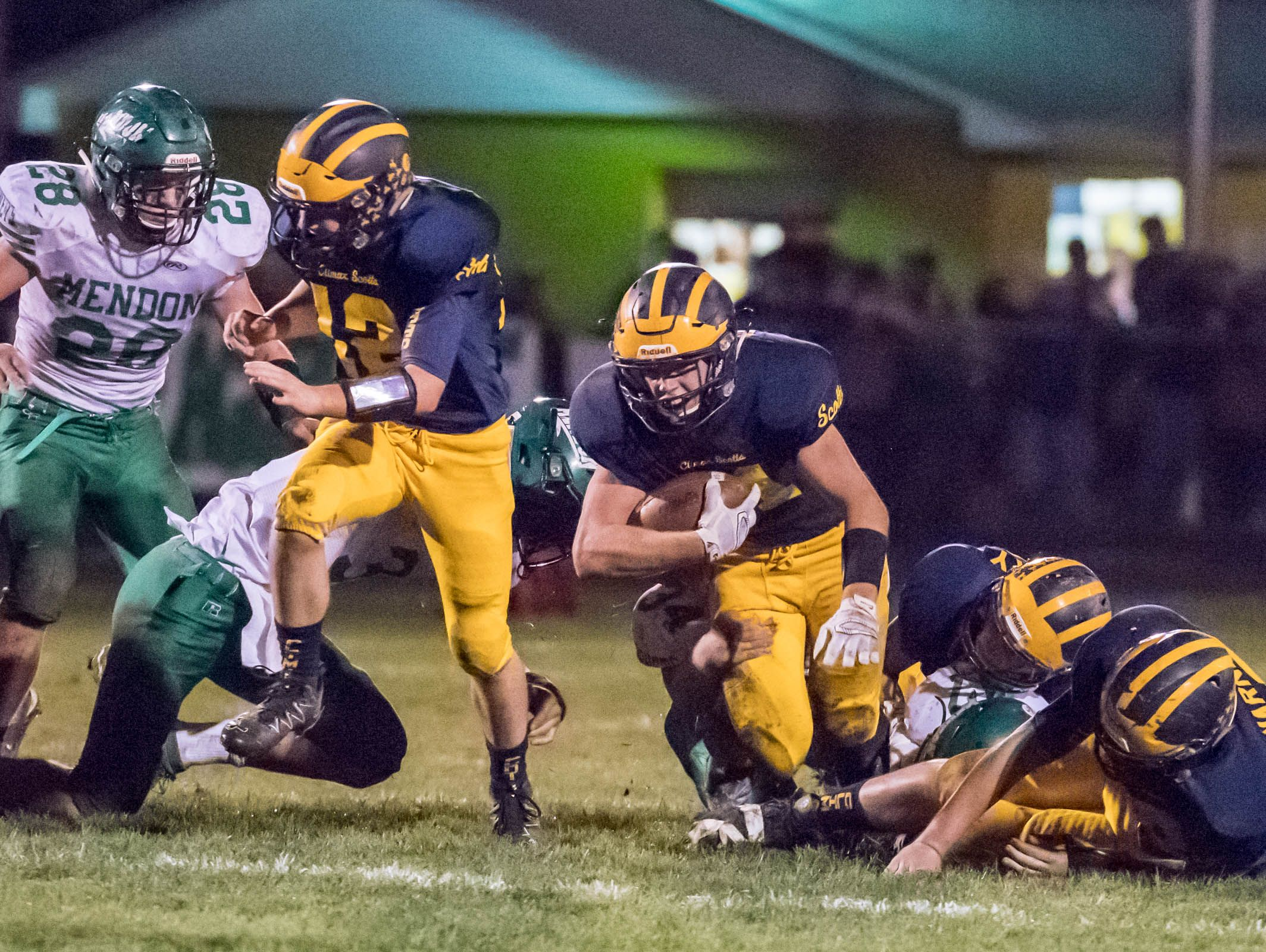 Climax-Scotts's Adam Schantz (20) grinds out for more yardage during first half action against Mendon in the second round of the playoffs