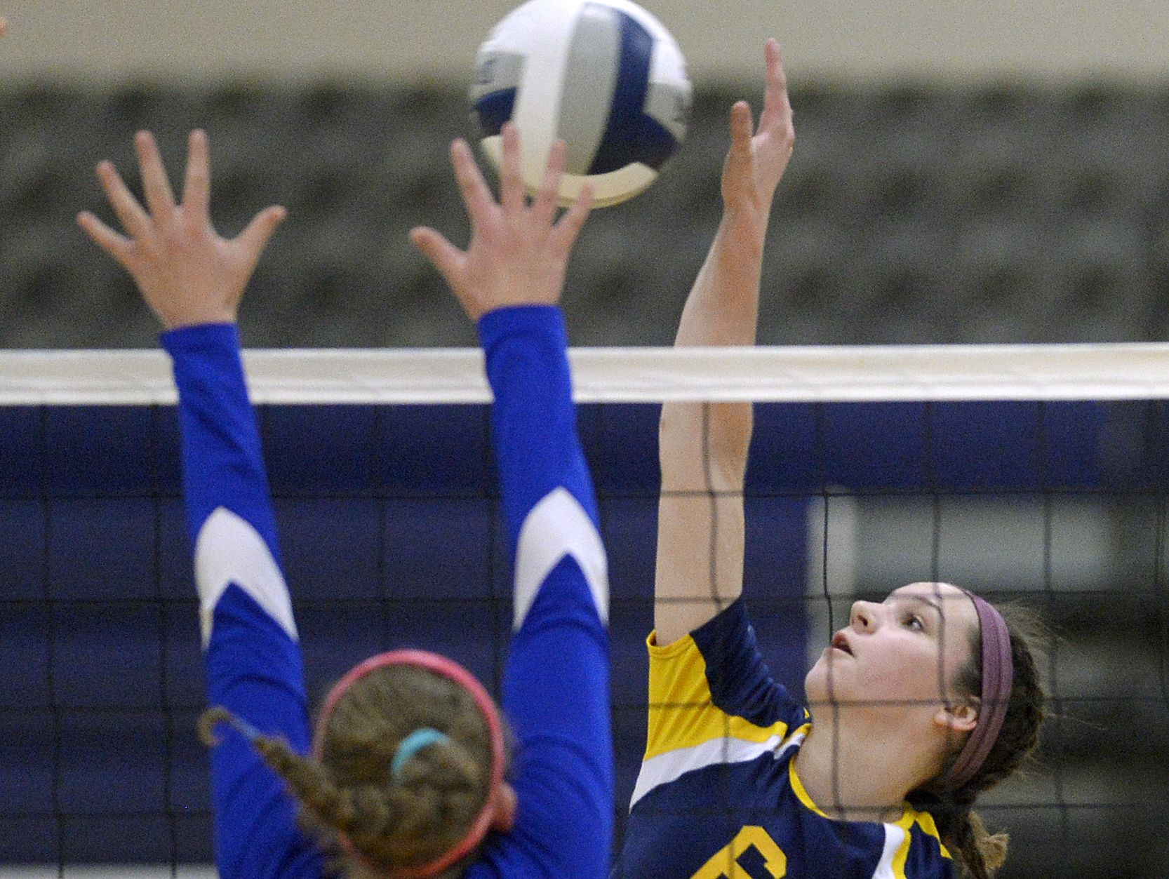 Pittsford Sutherland's Savannah Bothner, right, hits against the block of Irondequoit's Julie Cicotta during the Section V Class A final.