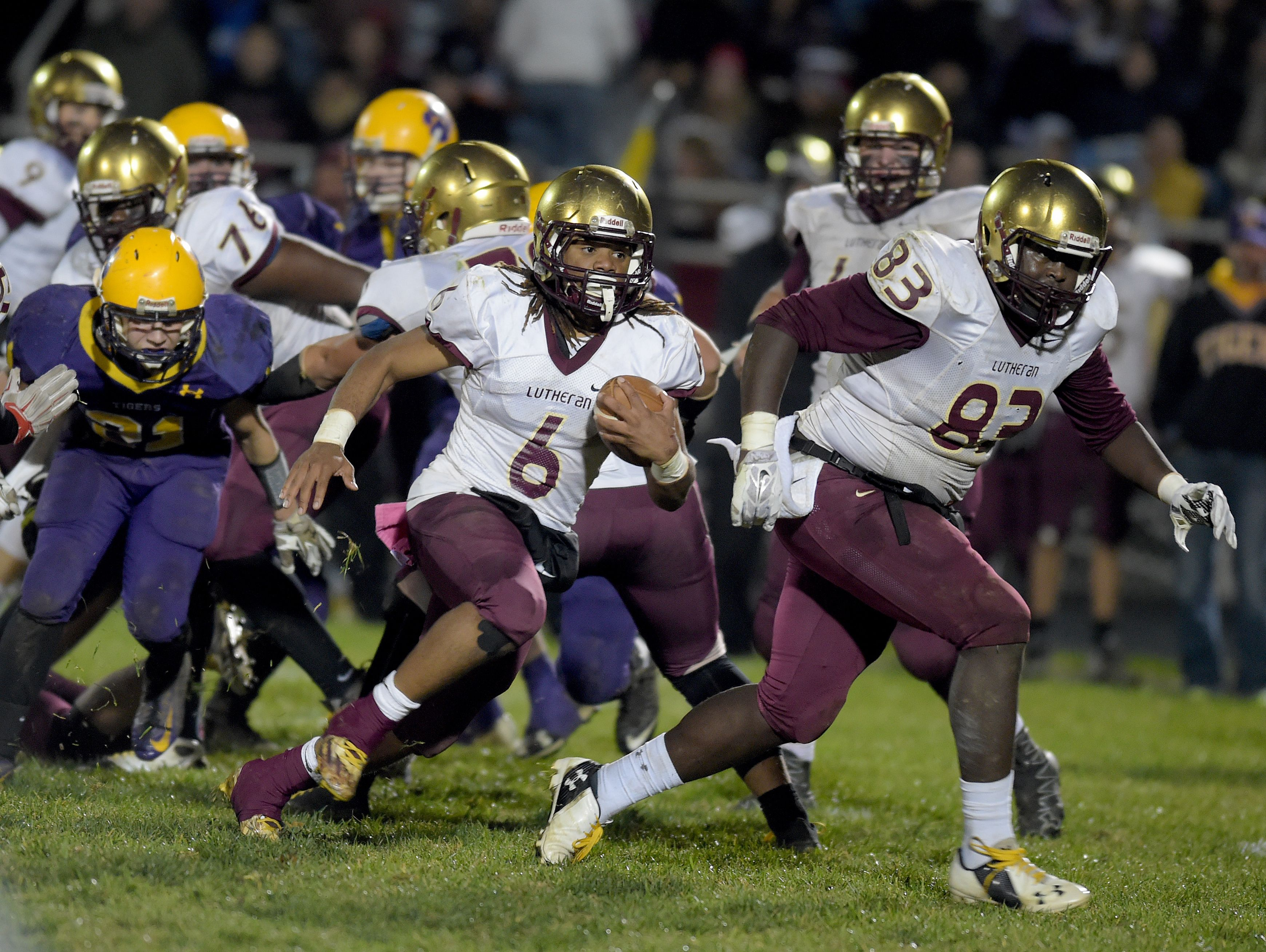 Indianapolis Lutheran's Andre Jones runs the ball against Hagerstown during a sectional football game Friday, Nov. 4, 2016 in Hagerstown.
