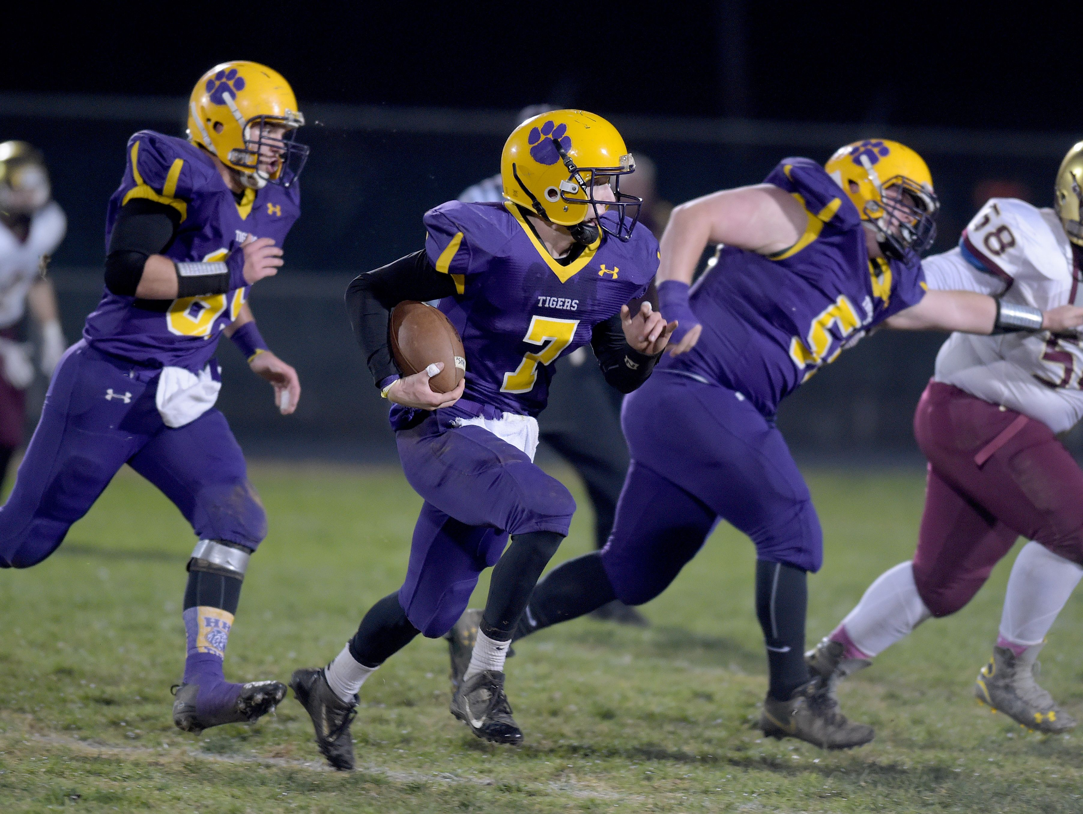 Hagerstown's Owen Golliher runs the ball against Indianapolis Lutheran during a sectional football game Friday, Nov. 4, 2016 in Hagerstown.