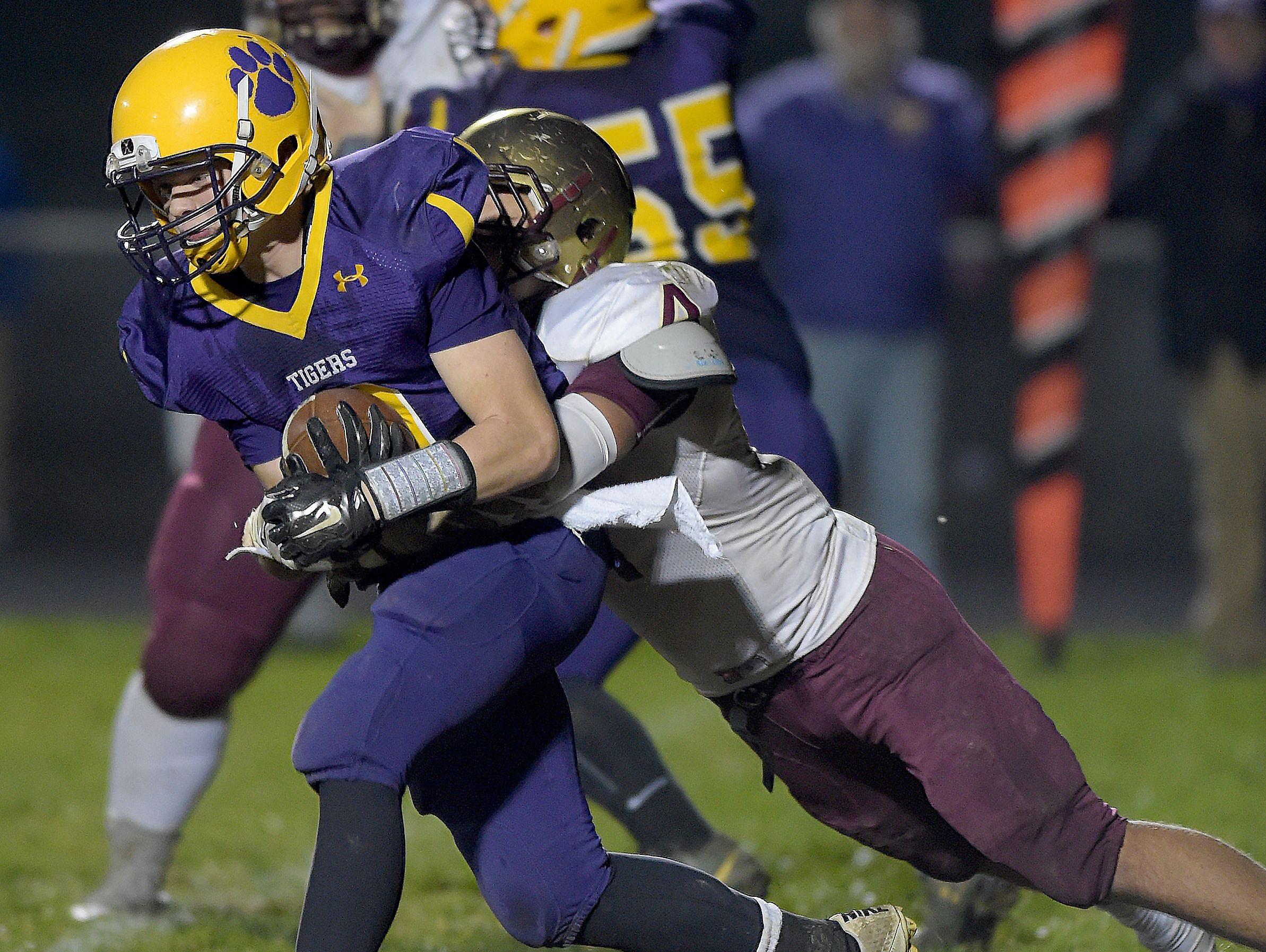 Hagerstown's Mason Hicks drags Indianapolis Lutheran's Bailey Barham during a sectional football game Friday, Nov. 4, 2016 in Hagerstown.