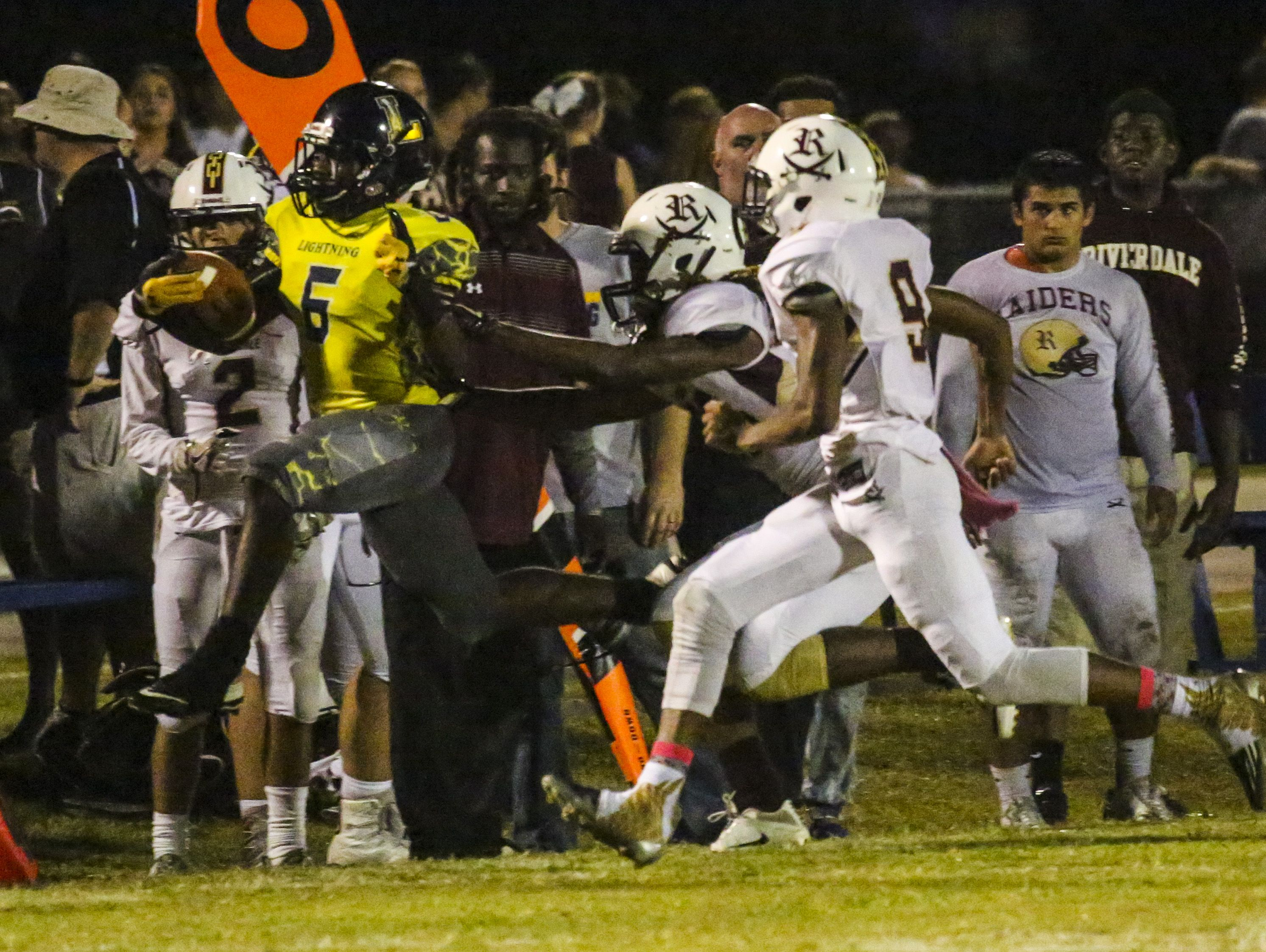 Lehigh's Jalane Nelson is pushed out of bounds as he gains yards for the Lightning during the Riverdale at Lehigh football game.