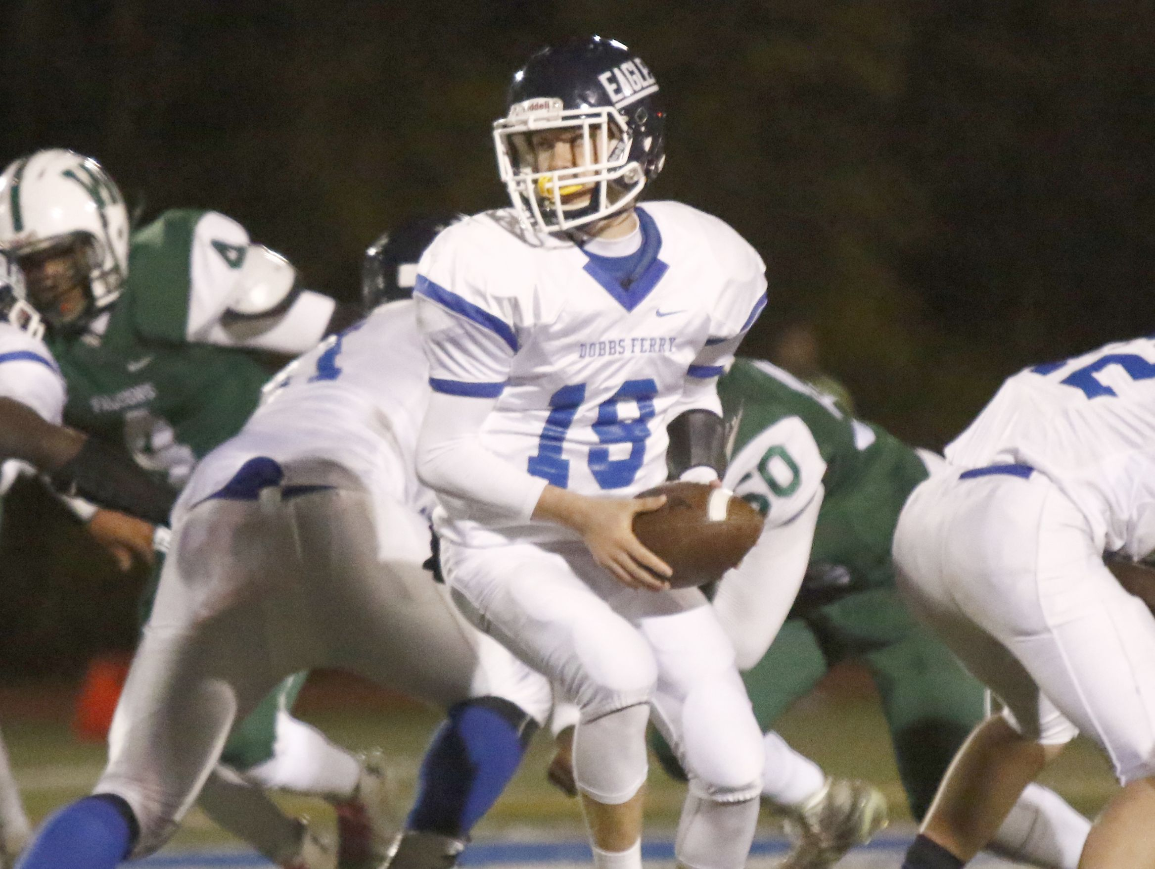 Dobbs Ferry quarterback Patrick Straub turns for a handoff during the Eagles' 21-14 win over Woodlands in the Section 1 Class C championship game at Mahopac High School on Friday.