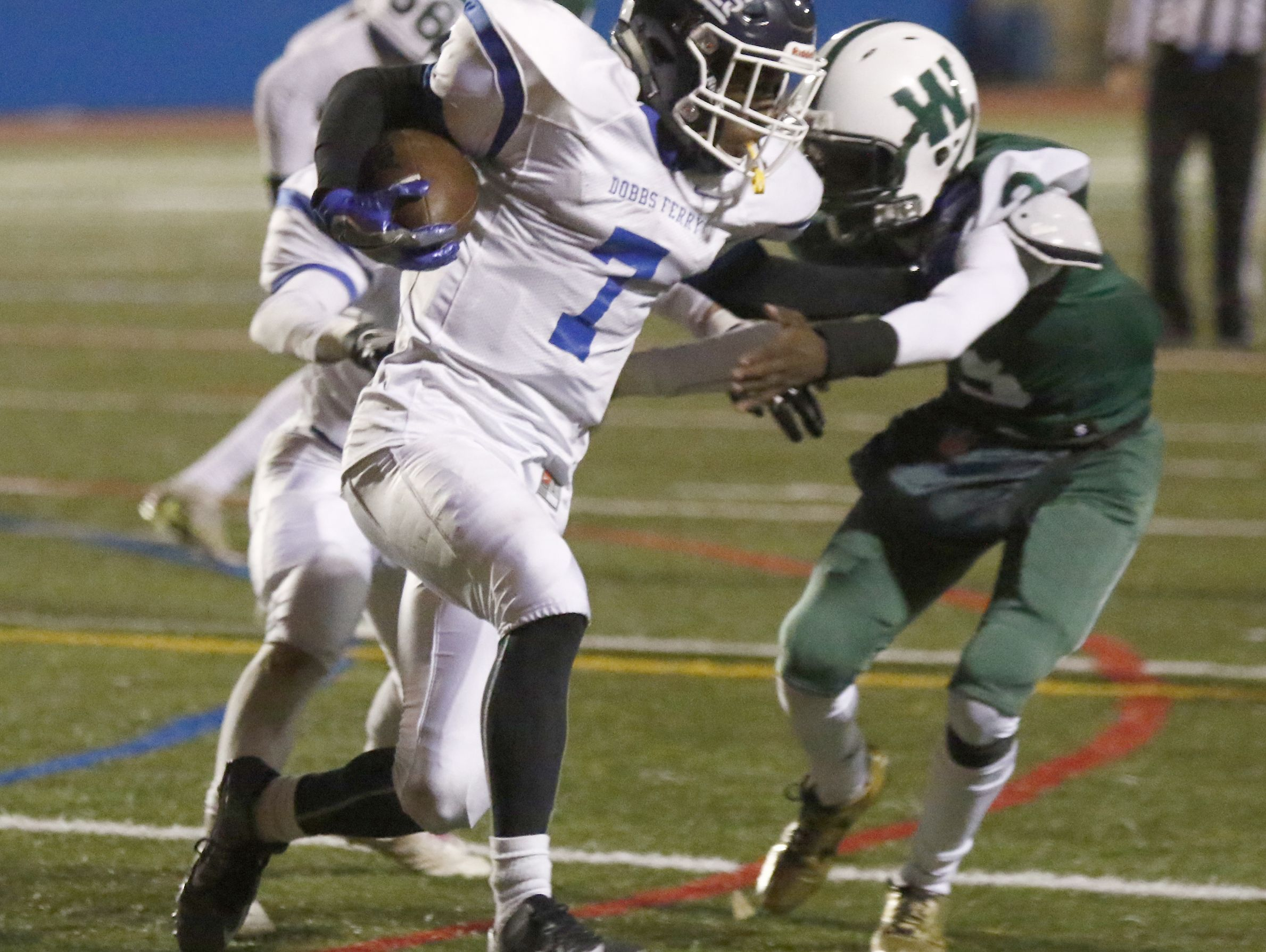 Dobbs Ferry's Najee Smith (7) with a carry during their 21-14 win over Woodlands in the Section 1 Class C championship football game at Mahopac High School on Friday, November 4, 2016.