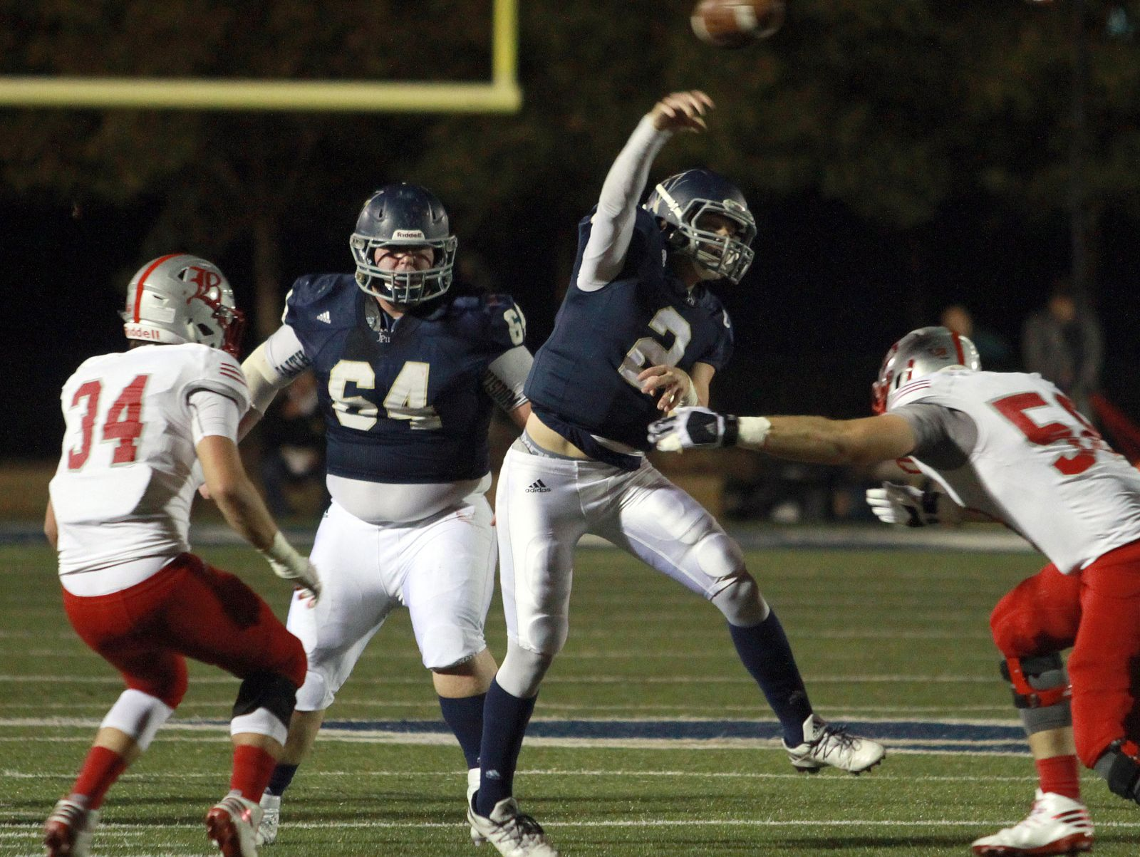Pope John Paul II QB Ben Brooks gets the pass of despite the rush of Baylor's Walker Culver in Hendersonville, TN on Fri. Nov. 4, 2016. Photo by Dave Cardaciotto