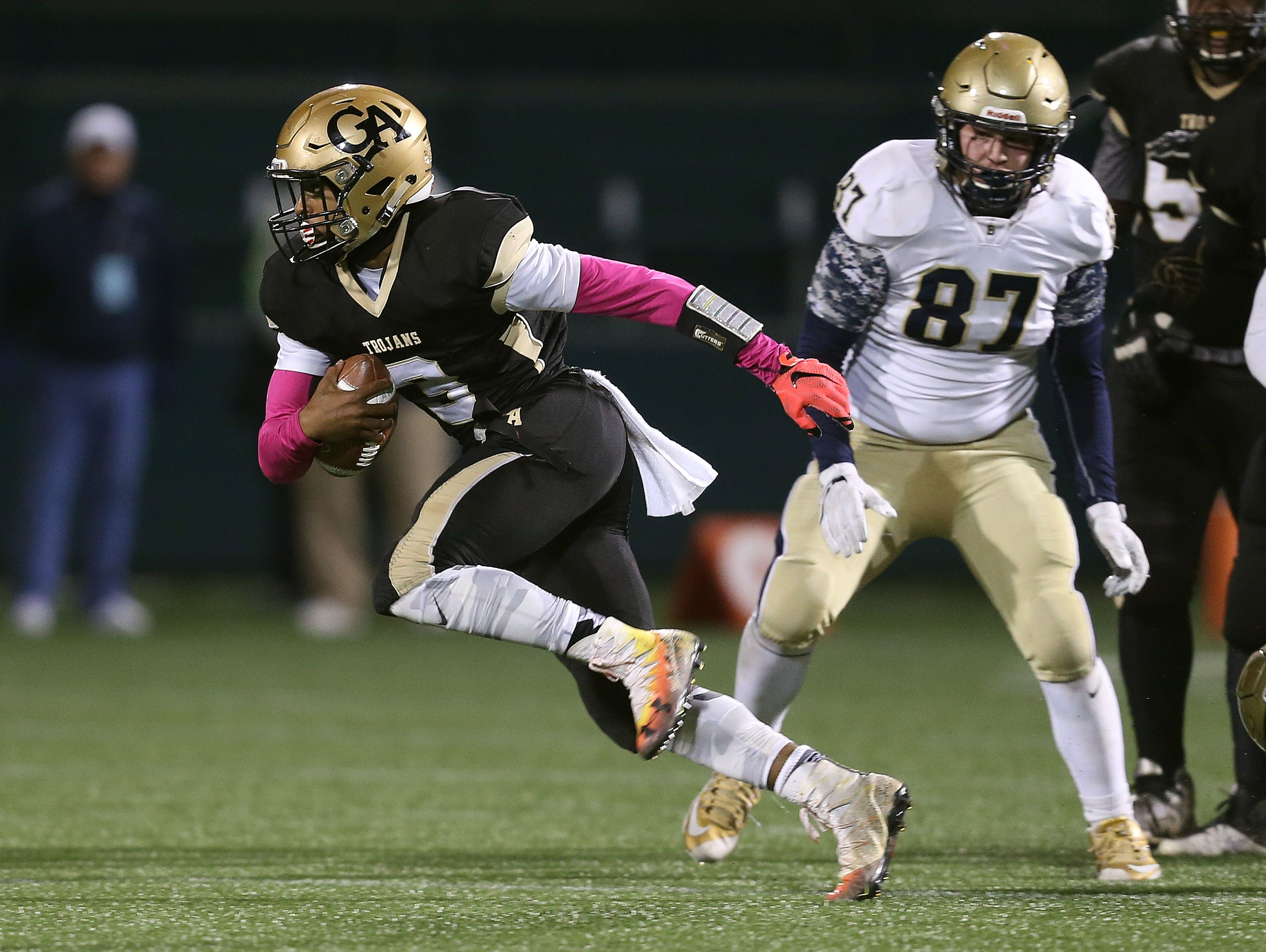 Athena quarterback Ta'von Granison looks for running room out of the pocket.