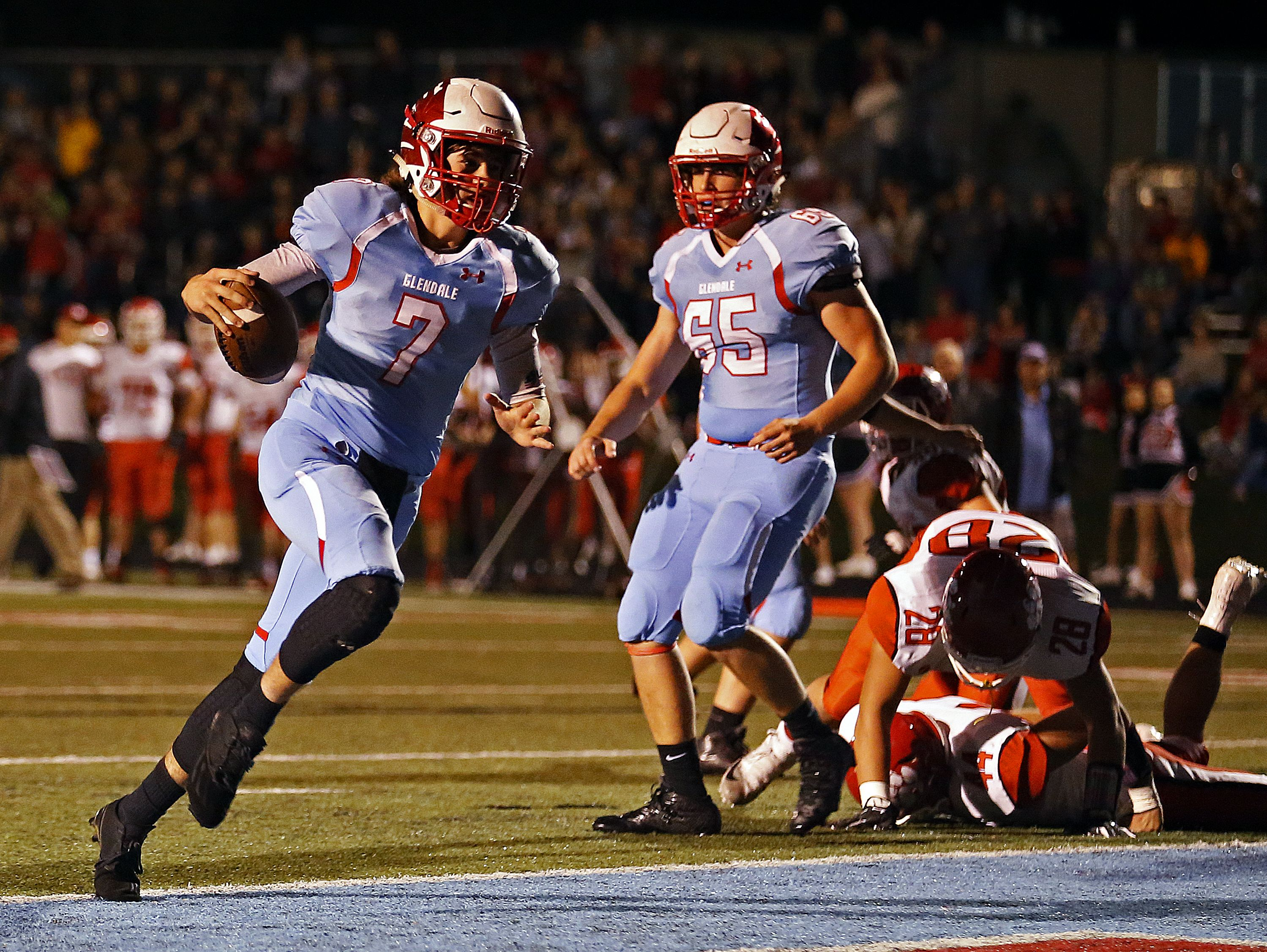 Glendale High School quarterback Alex Huston (7) walks into the end zone to score on a two-point conversion during first quarter action of the playoff game between Glendale High School and Ozark High School at Lowe Stadium in Springfield, Mo. on Nov. 4, 2016.