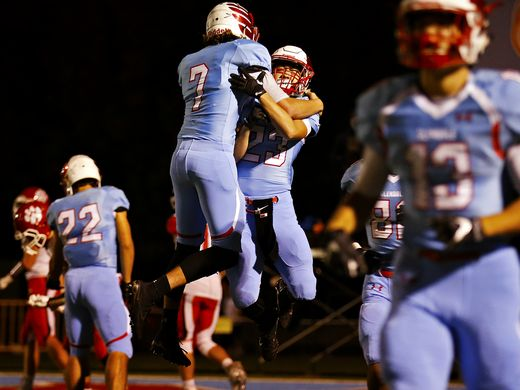 Glendale High School quarterback Alex Huston (7) and wide receiver Nader Leali (23) celebrate after Leali scored a touchdown during first quarter action of the playoff game between Glendale High School and Ozark High School at Lowe Stadium in Springfield, Mo. on Nov. 4, 2016 Guillermo Hernandez Martinez/News-Leader