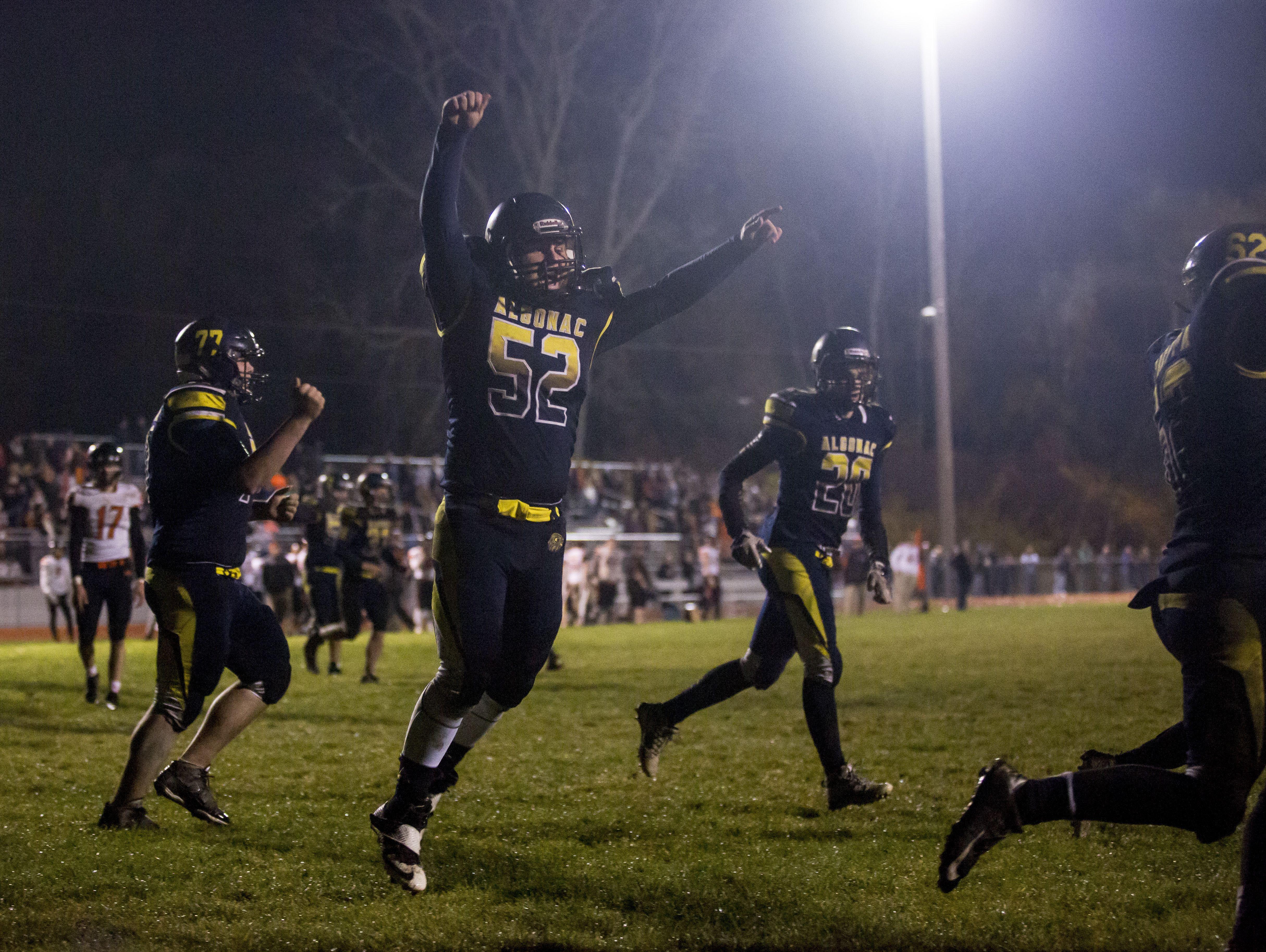 Algonac's Donovan Huber celebrates during a football game Friday, Nov. 4, 2016 at Algonac High School.