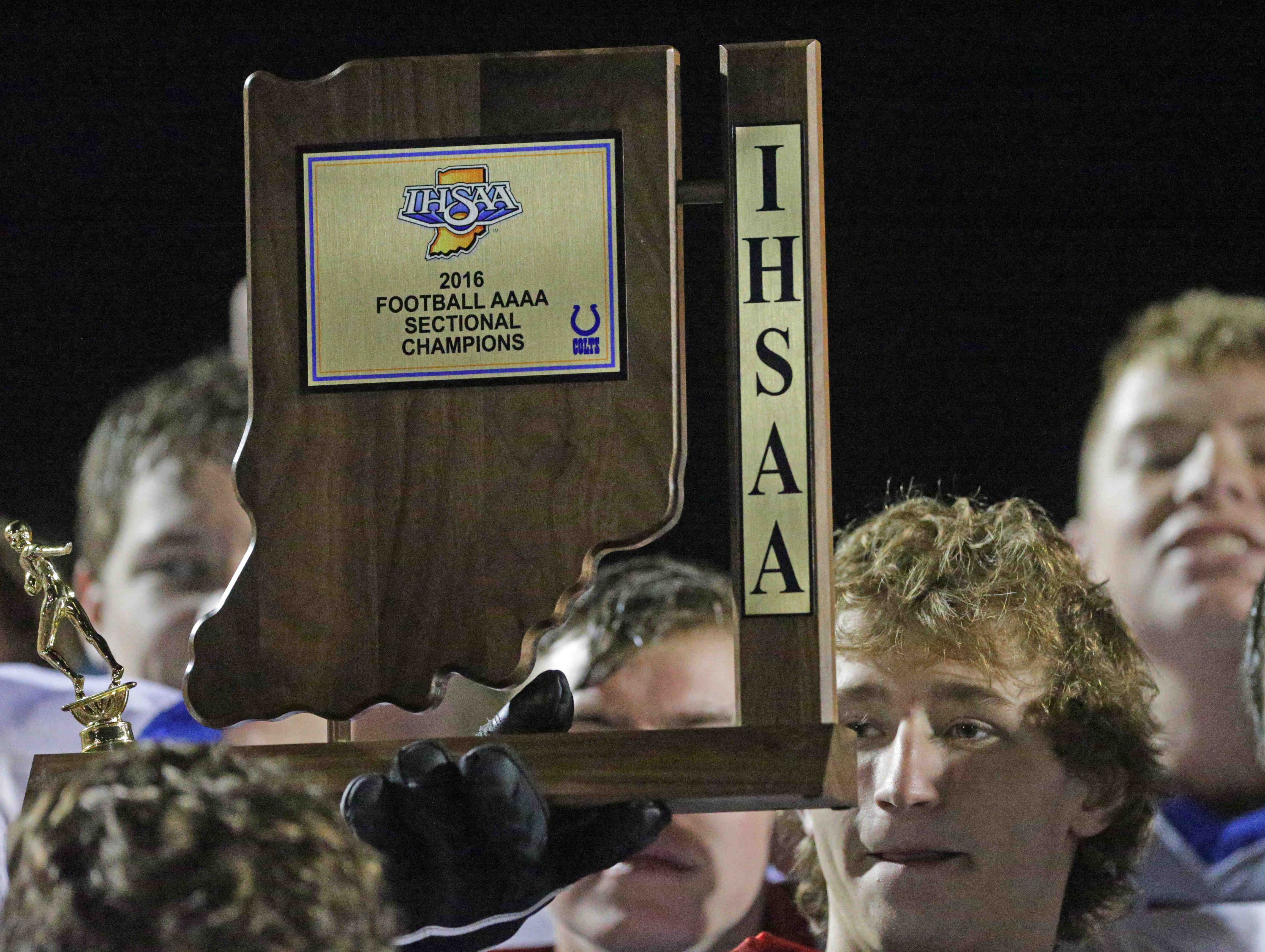 Roncalli celebrates their sectional win over Greenwood Community High School, at Greenwood, Friday November 4th, 2016.