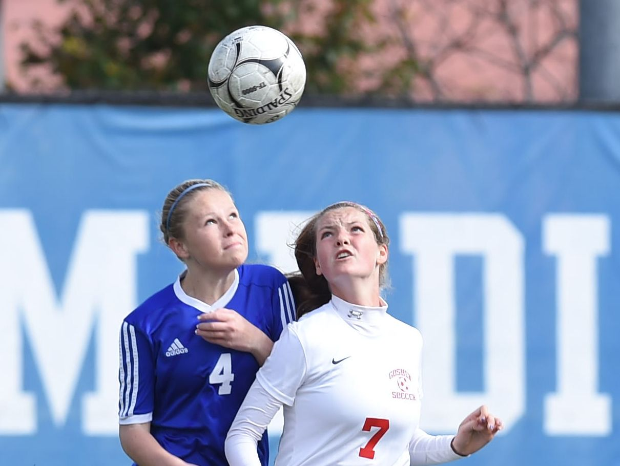 Pearl River's Kerry Tyer, left, and Goshen's Alex Stack, right, fight for the ball during Saturday's Class A regional final.