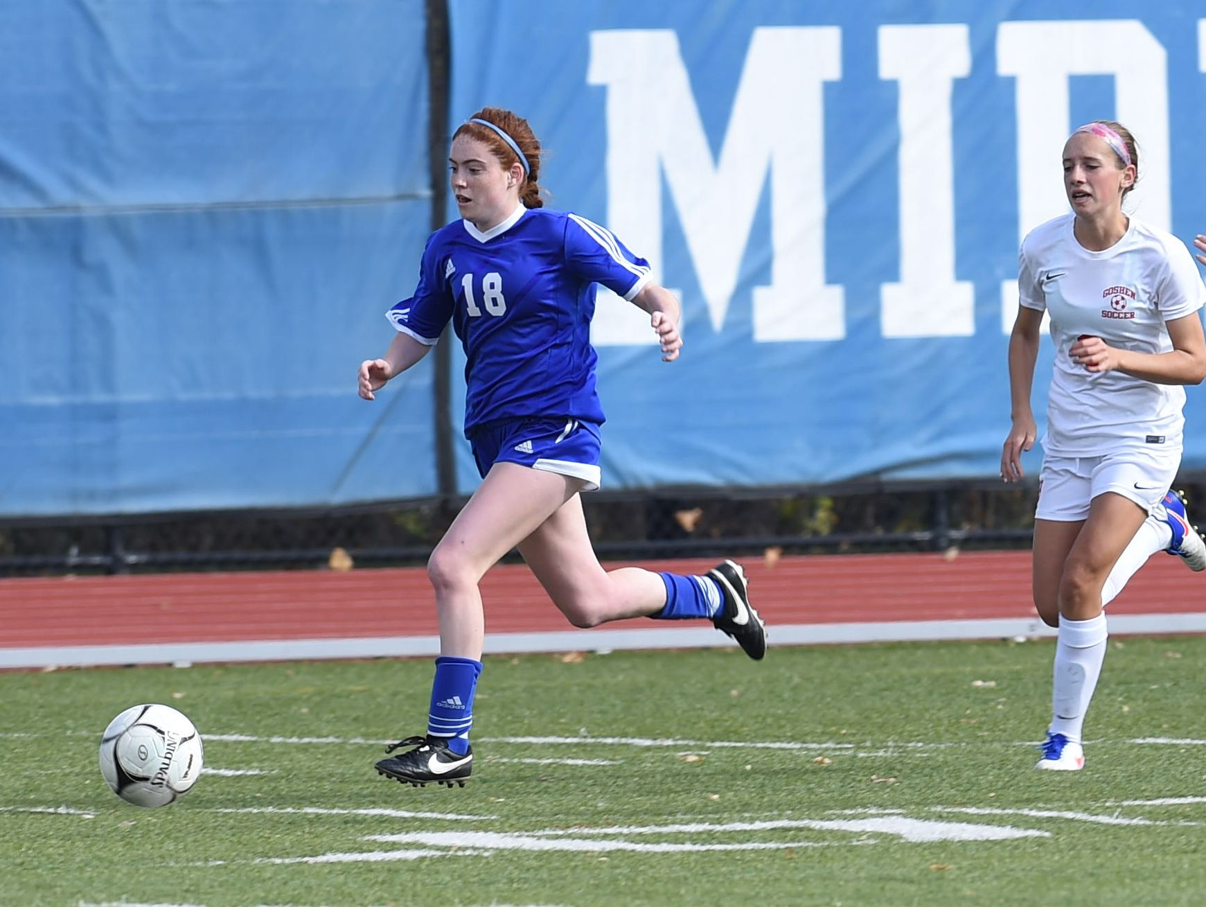 Pearl River's Shaelynn Guilfoyle, left, takes the ball down the field during Saturday's Class A regional final against Goshen.