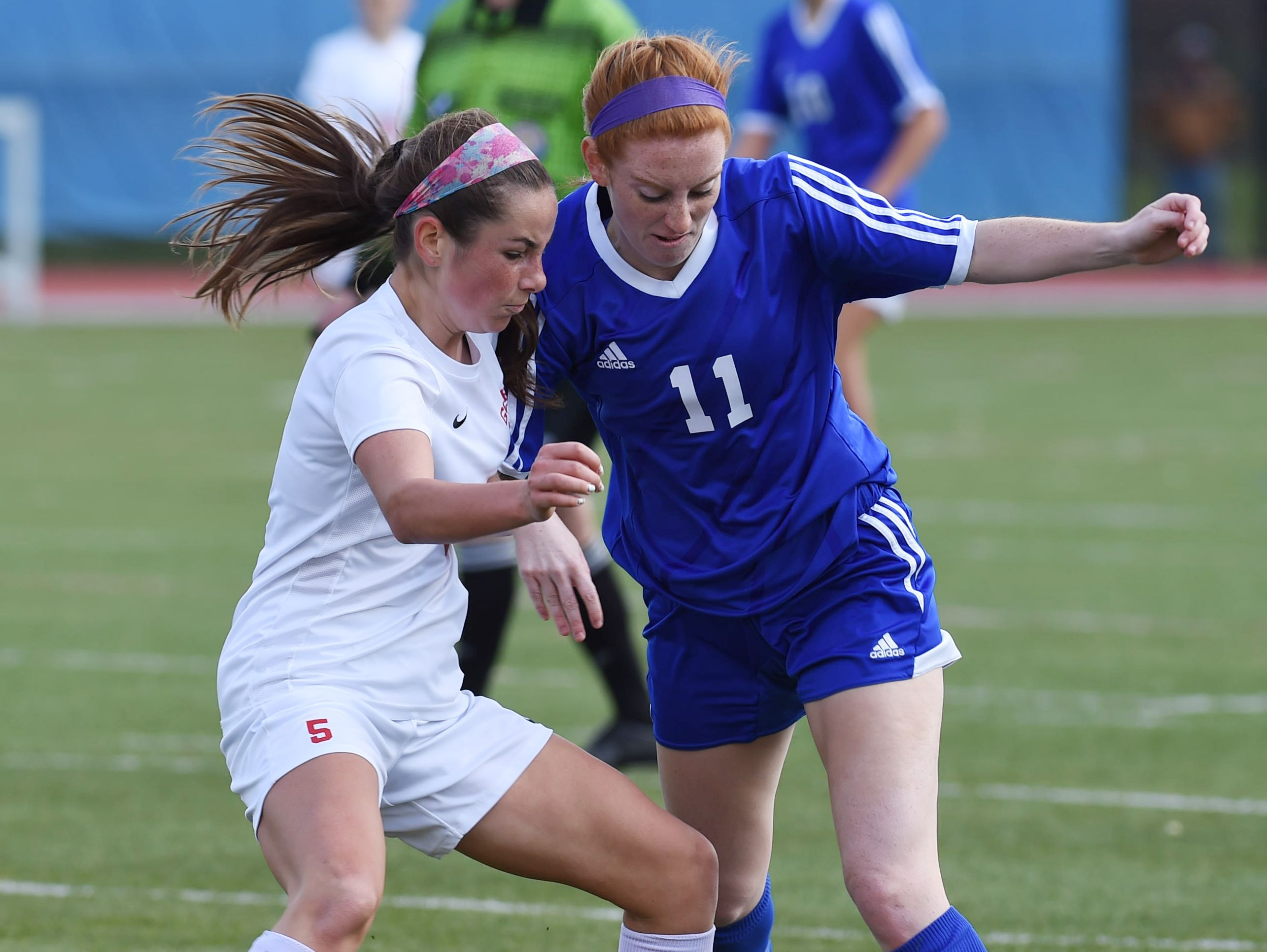 Pearl River's Tara Guilfoyle, right, and Goshen's Skylar Stitskin, left, fight for the ball during Saturday's Class A regional final.